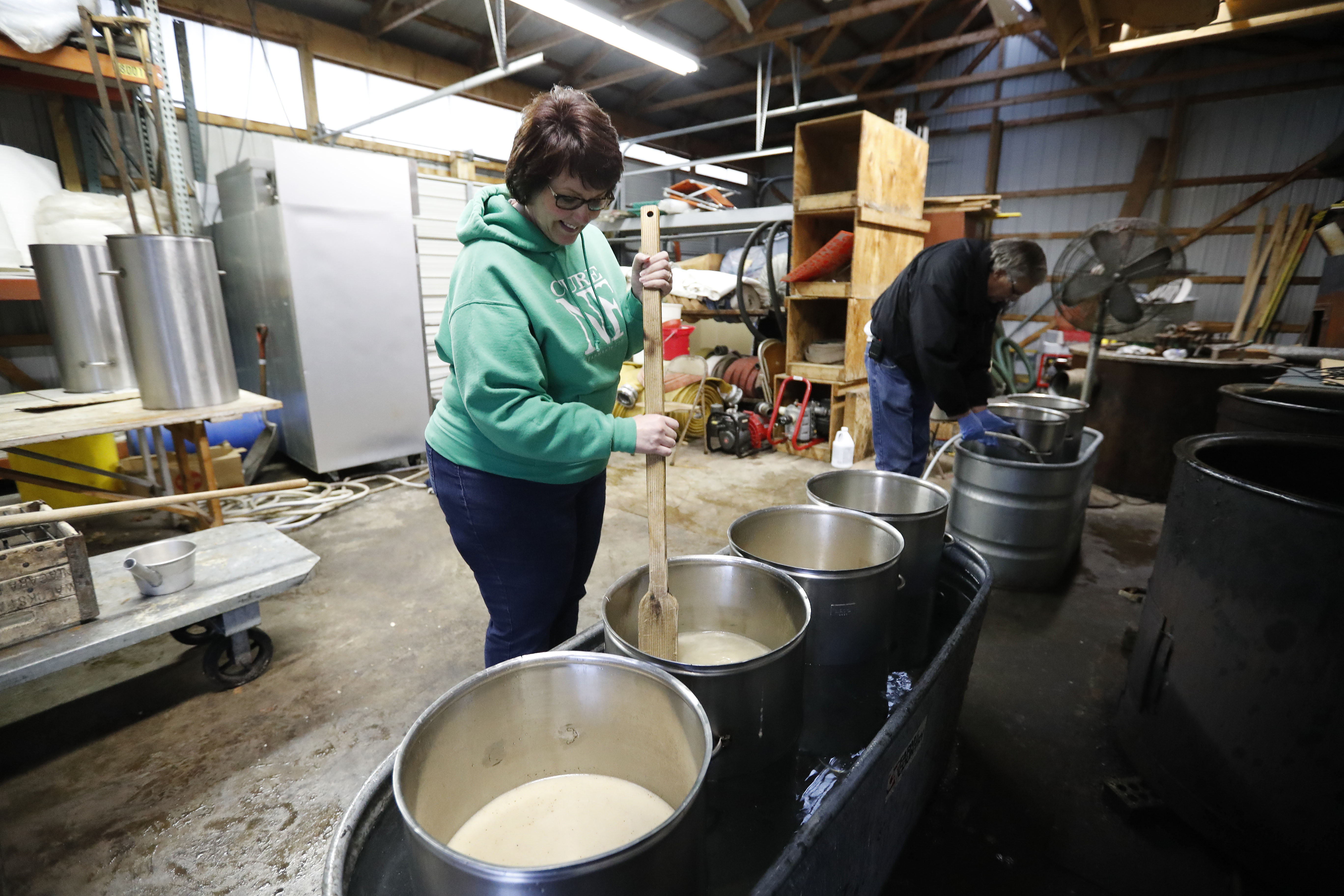 Jennifer Wittkowsky and Art Kroening get the broth ready for the month's chicken chowder sales at the Bergholz Fire department in Wheatfield.  The chowder has been a tradition of the  department for decades. (Mark Mulville/Buffalo News)