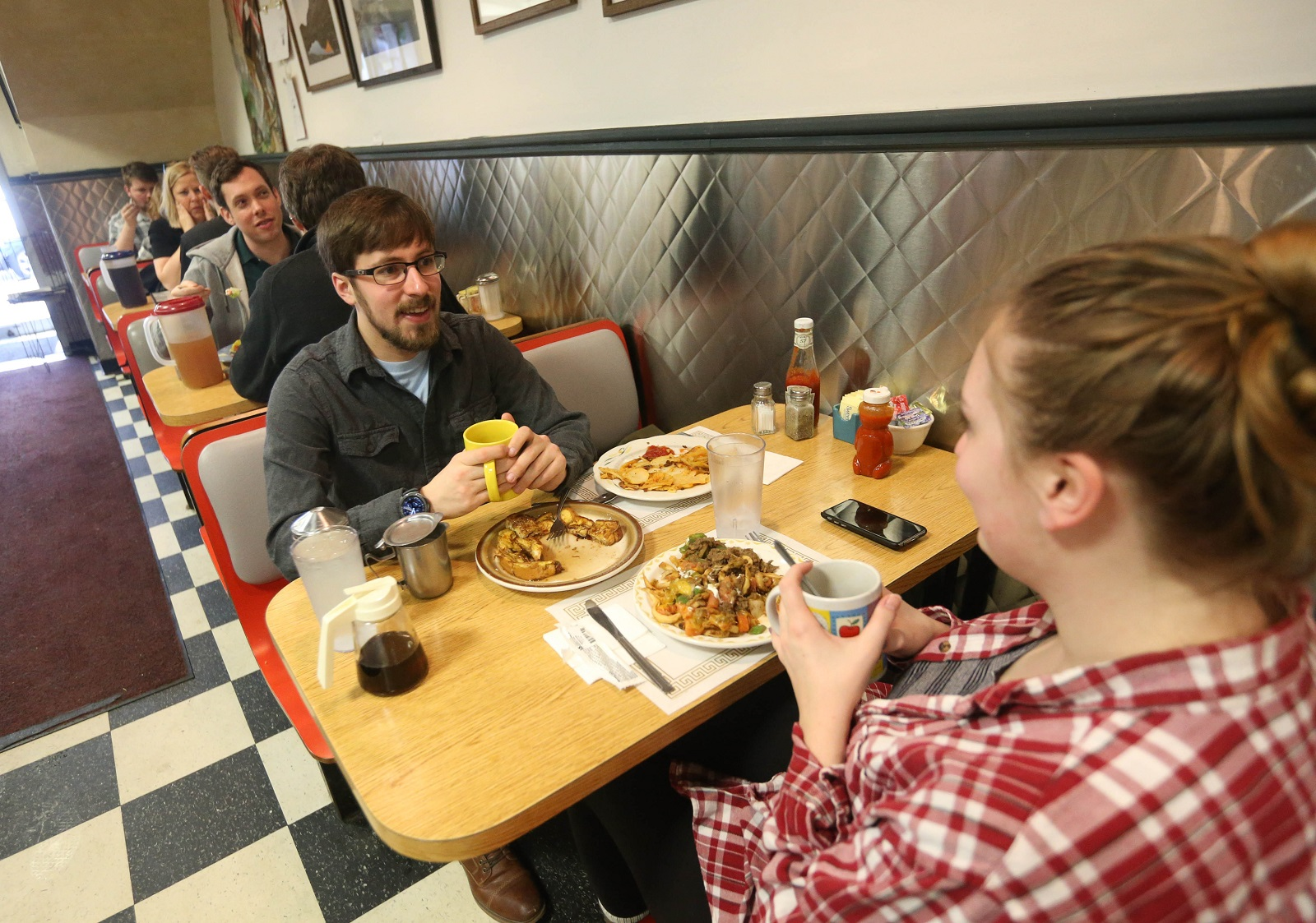 University at Buffalo students Justin Fields, left, and Amelia Veitch have lunch in Amy's Place. (Sharon Cantillon/Buffalo News)