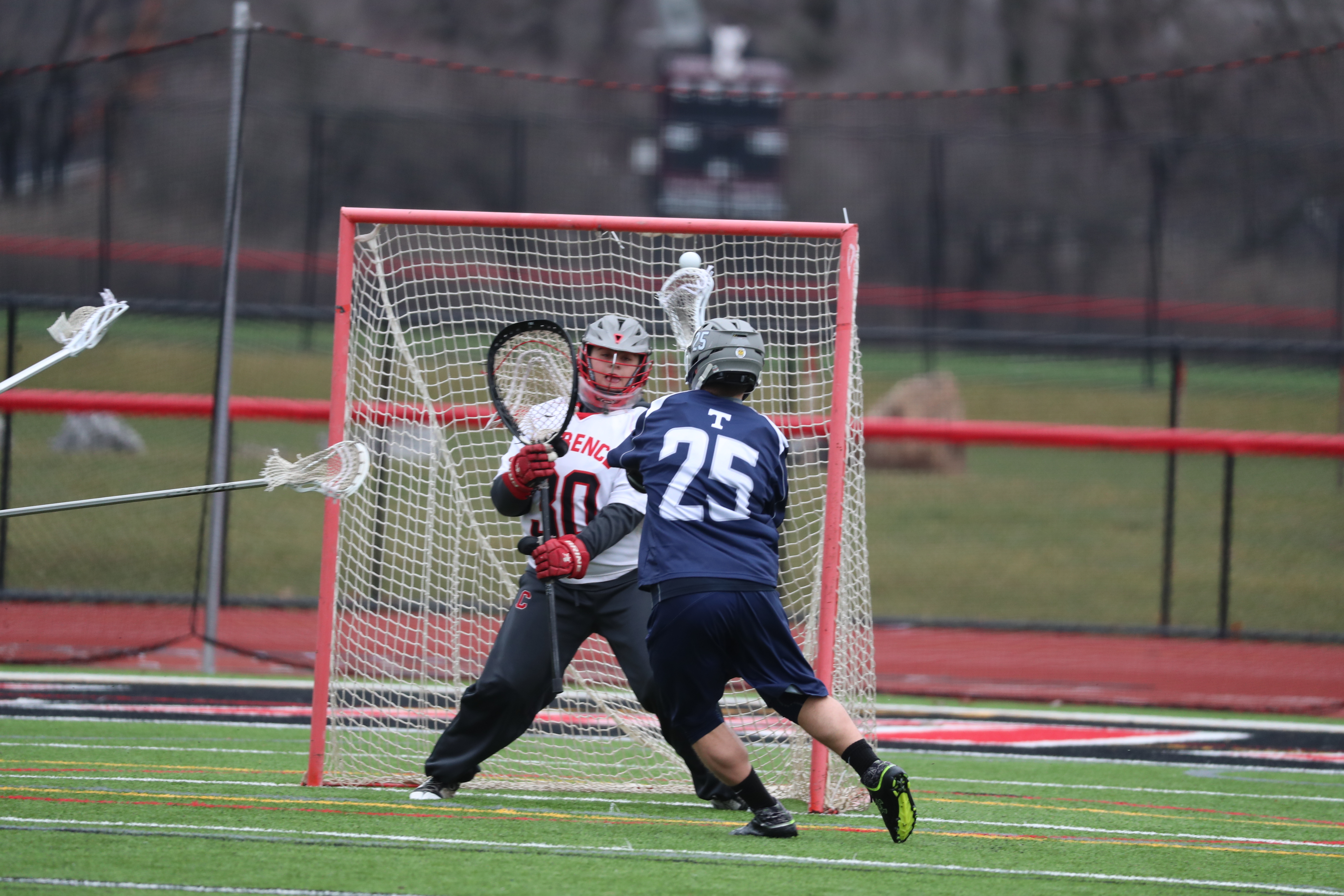 Clarence's Andy Avarello can't stop the shot by Webster Thomas'  Trevor Ford during Saturday's game at Clarence. (James P. McCoy/Buffalo News)