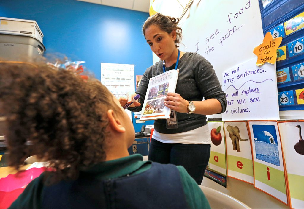 Herman Badillo Bilingual Academy ESL teacher Shawna Hnatyszyn teaches a test preparation unit to her students. (Robert Kirkham/Buffalo News)