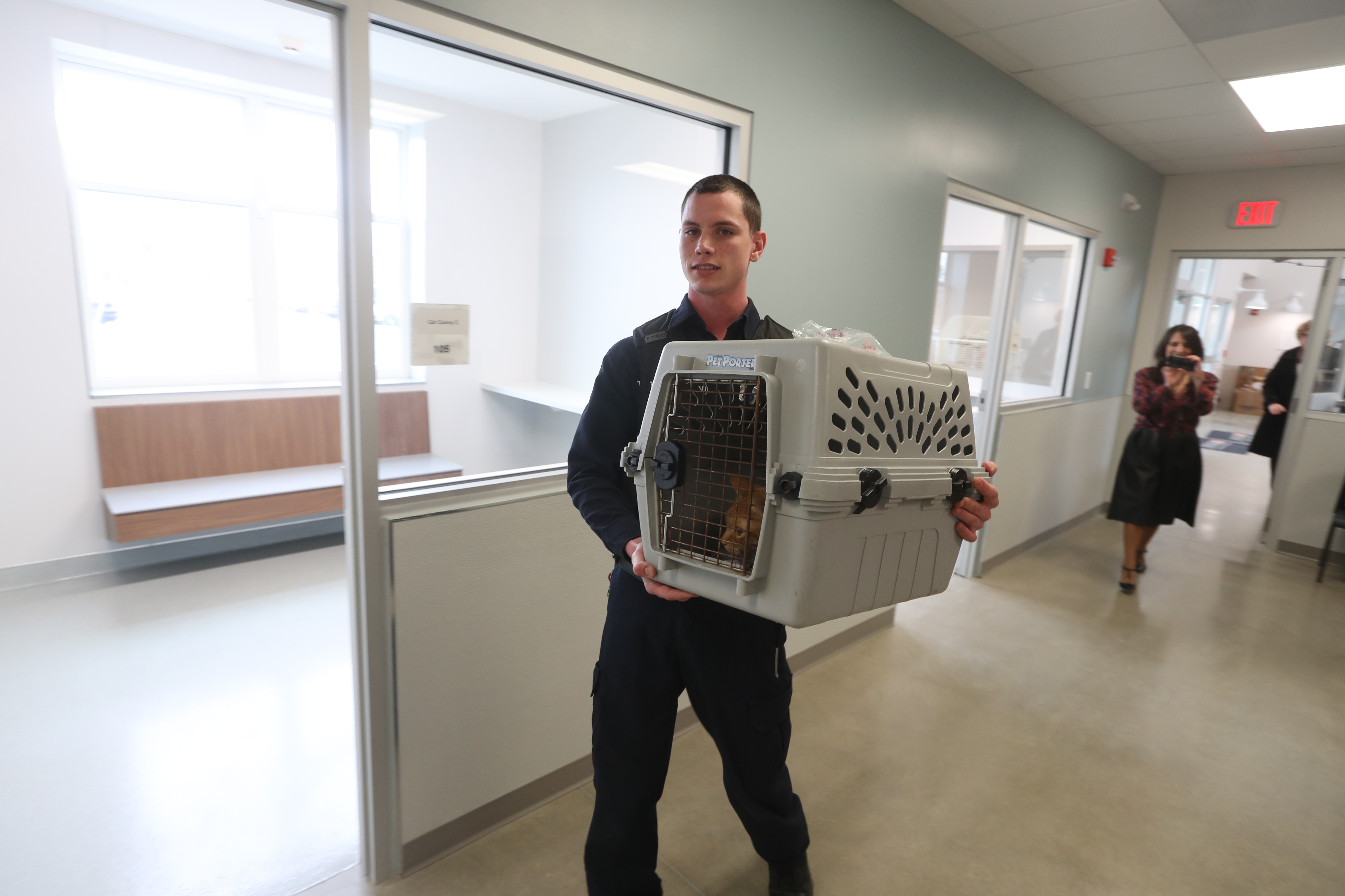 Tyler Robertson a animal cruelty investigator, brings in a cat from old SPCA to the  the SPCA's new Location in West Seneca on Wednesday April 5, 2017. (John Hickey/Buffalo News)