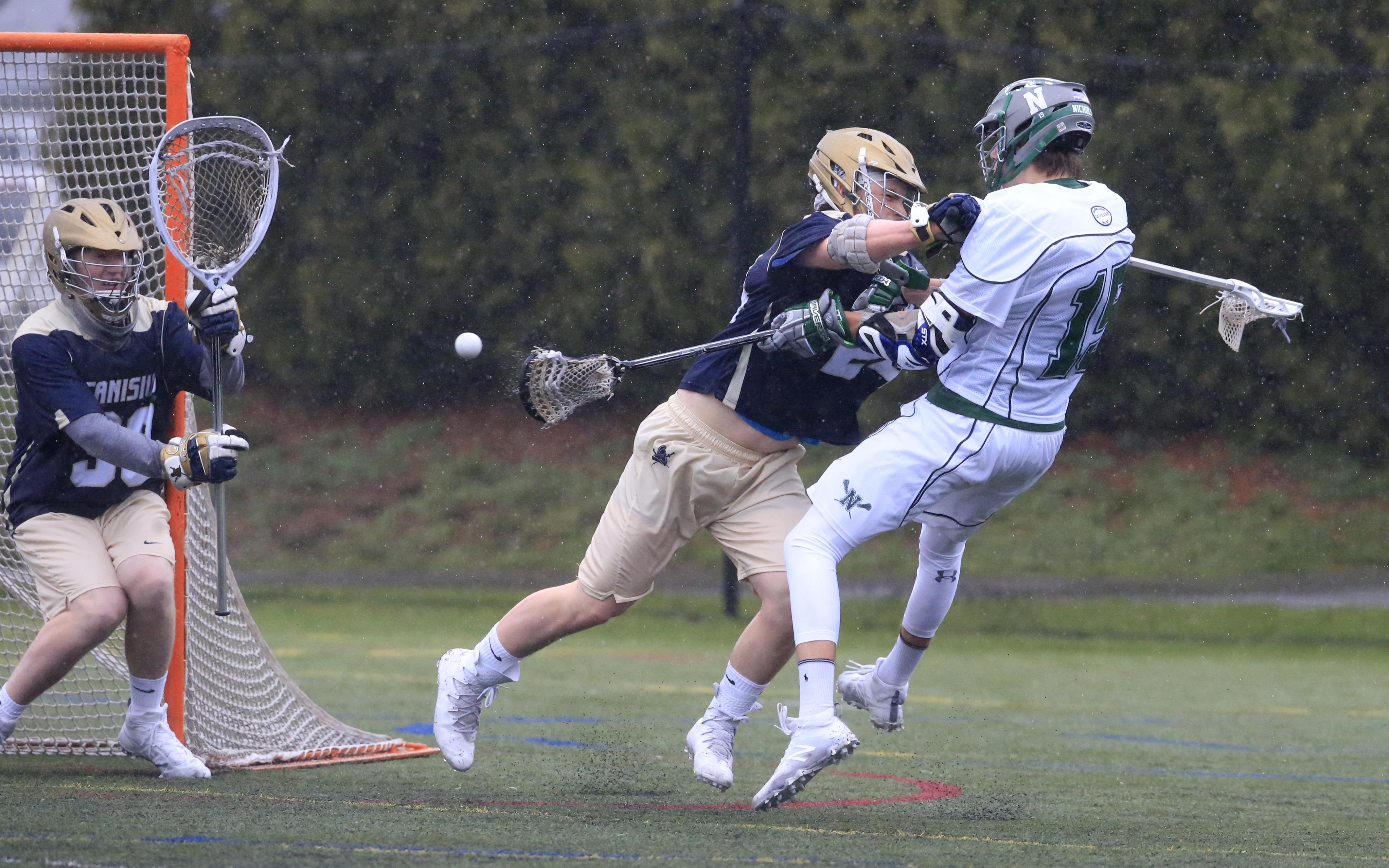 Canisius' Peter Zittel takes out Nichols' Matt Berdysiak during Thursday's boys lacrosse game at Nichols. (Harry Scull Jr./Buffalo News)