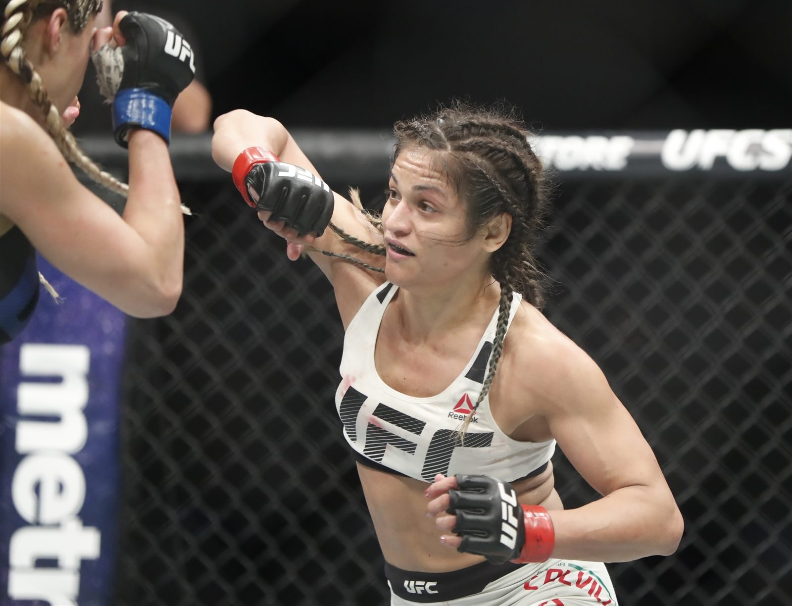 Cynthia Calvillo defeats Pearl Gonzalez during UFC 210 at KeyBank Center. (Harry Scull Jr./Buffalo News)