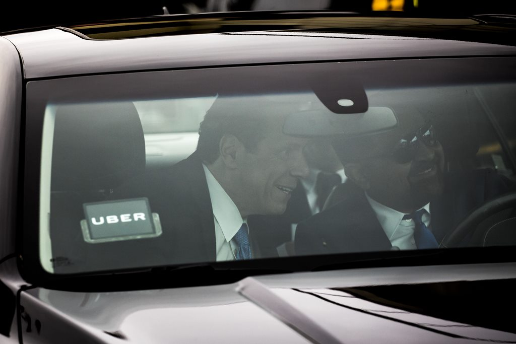 New York Gov. Andrew Cuomo arrives in an Uber with driver Tariq Nawaz for an event to highlight the newly passed state budget at the Rev. Smith Family Life Center in Buffalo, Tuesday, April 11, 2017.  (Derek Gee/Buffalo News)