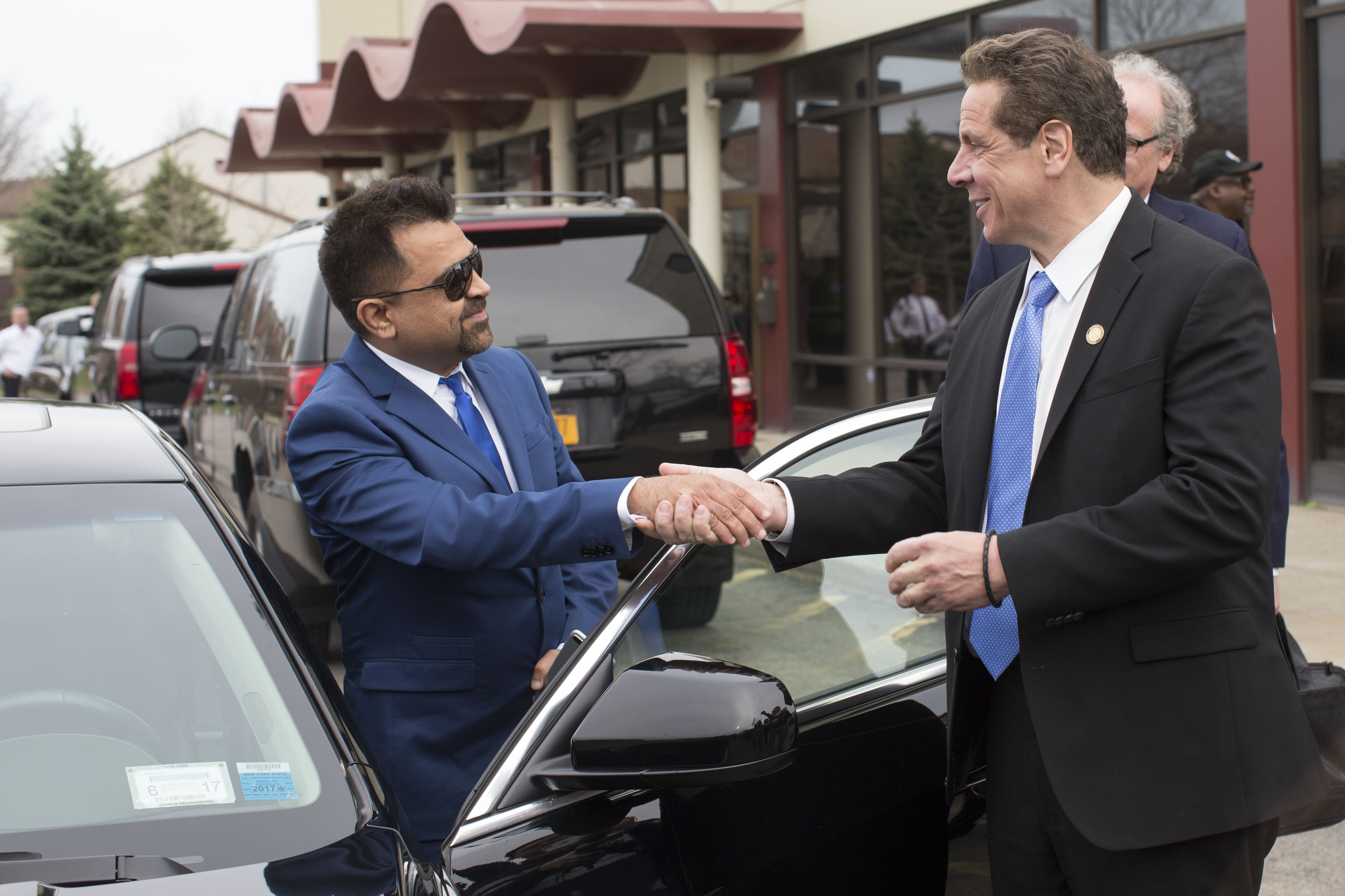 Gov. Cuomo thanks Uber driver Tariq Nawaz after Nawaz dropped him off at an event at the Rev. Smith Family Life Center, Tuesday, April 11, 2017. (Derek Gee/Buffalo News)