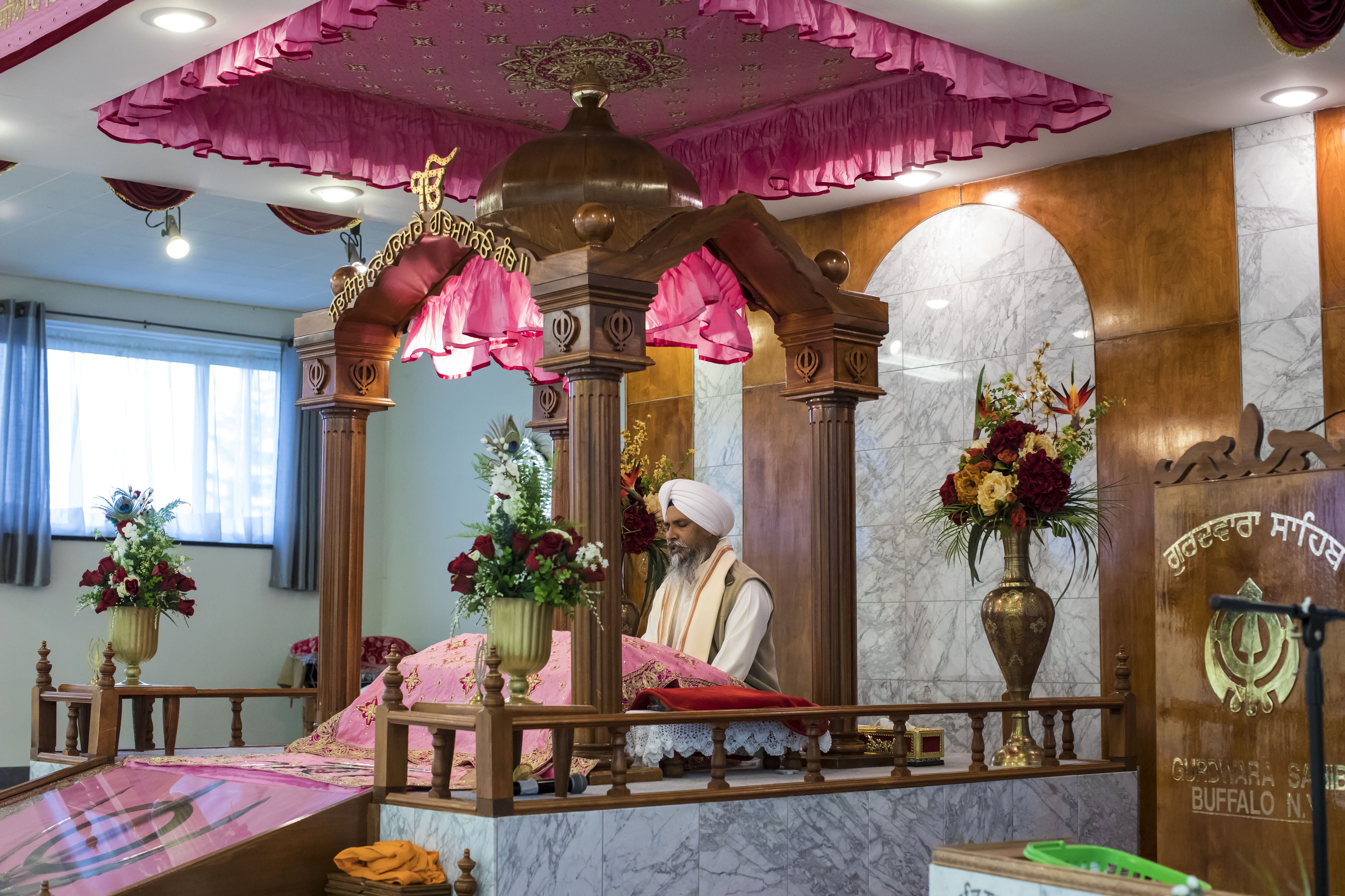Sujen Singh, the Gran Thi (or Sikh priest,) recites scripture from his place in a shrine called a palki during a service leading up to the Sikh holiday Vaisakhi at the Gurdwara Sahib in Amherst., Wednesday, April 12, 2017.  The Sikh Cultural and Educational Society of Western New York plans to build a new Gurdwara on a property they own next door to accommodate the community's growing population.  (Derek Gee/Buffalo News)