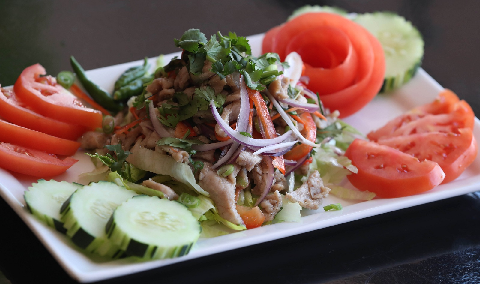 Taste of Siam's Lahb is a salad with a choice of chopped meat seasoned with Thai herbs, red onions, lemongrass, red peppers, mint leaves, cilantro, lime juice and smoked jasmine rice. (Sharon Cantillon/Buffalo News)