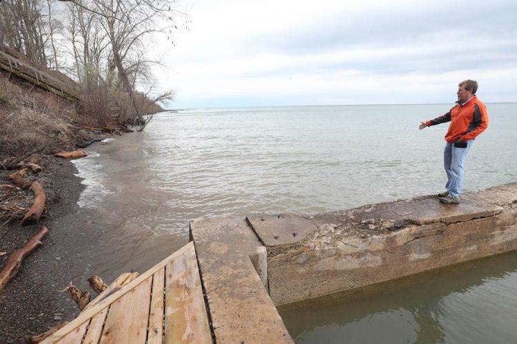 Beach disappears, bank erodes as Lake Ontario keeps rising
