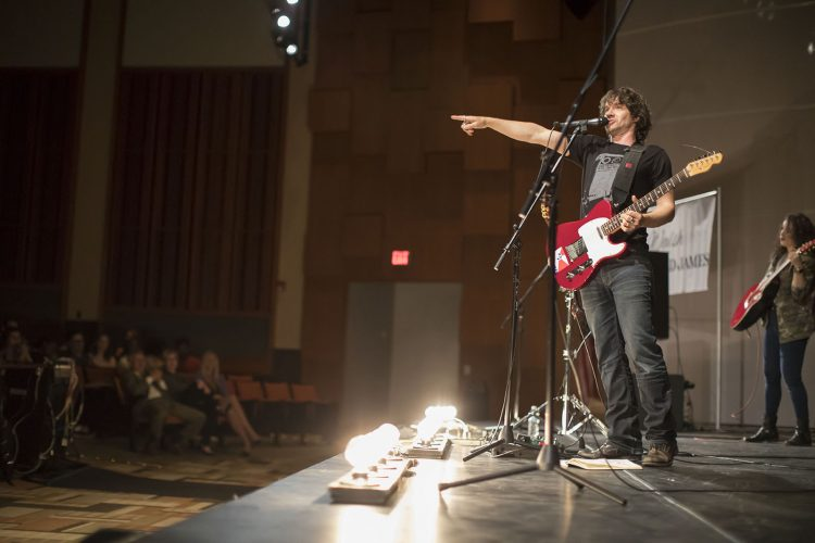 A rock band talked money, and Buffalo students listened