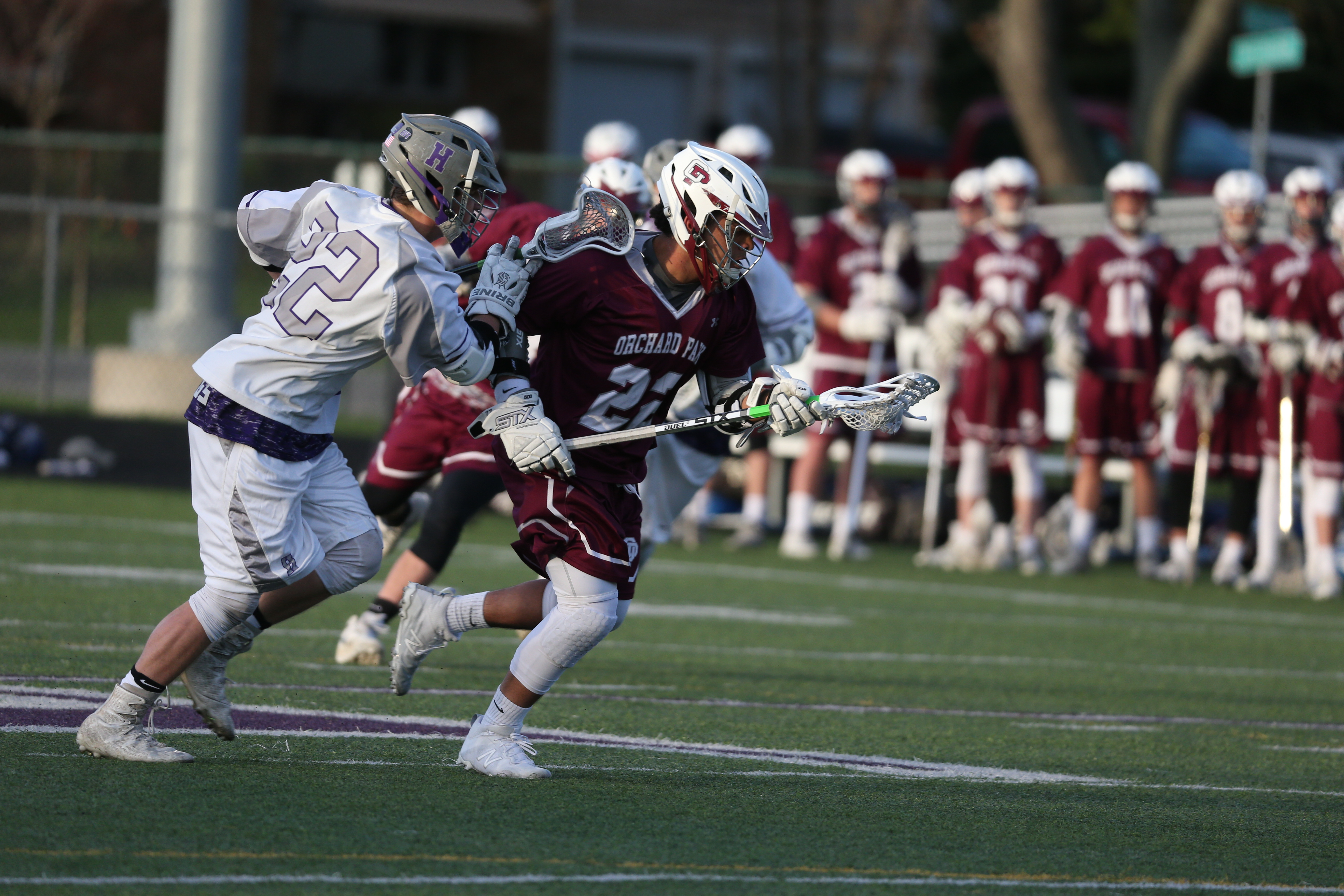 Orchard Park's Mitchell Streety pulls away with the ball from Hamburg's John Collins during Saturday's clash between reigning Section VI champions at Howe Field in Hamburg.  (James P. McCoy/Buffalo News)