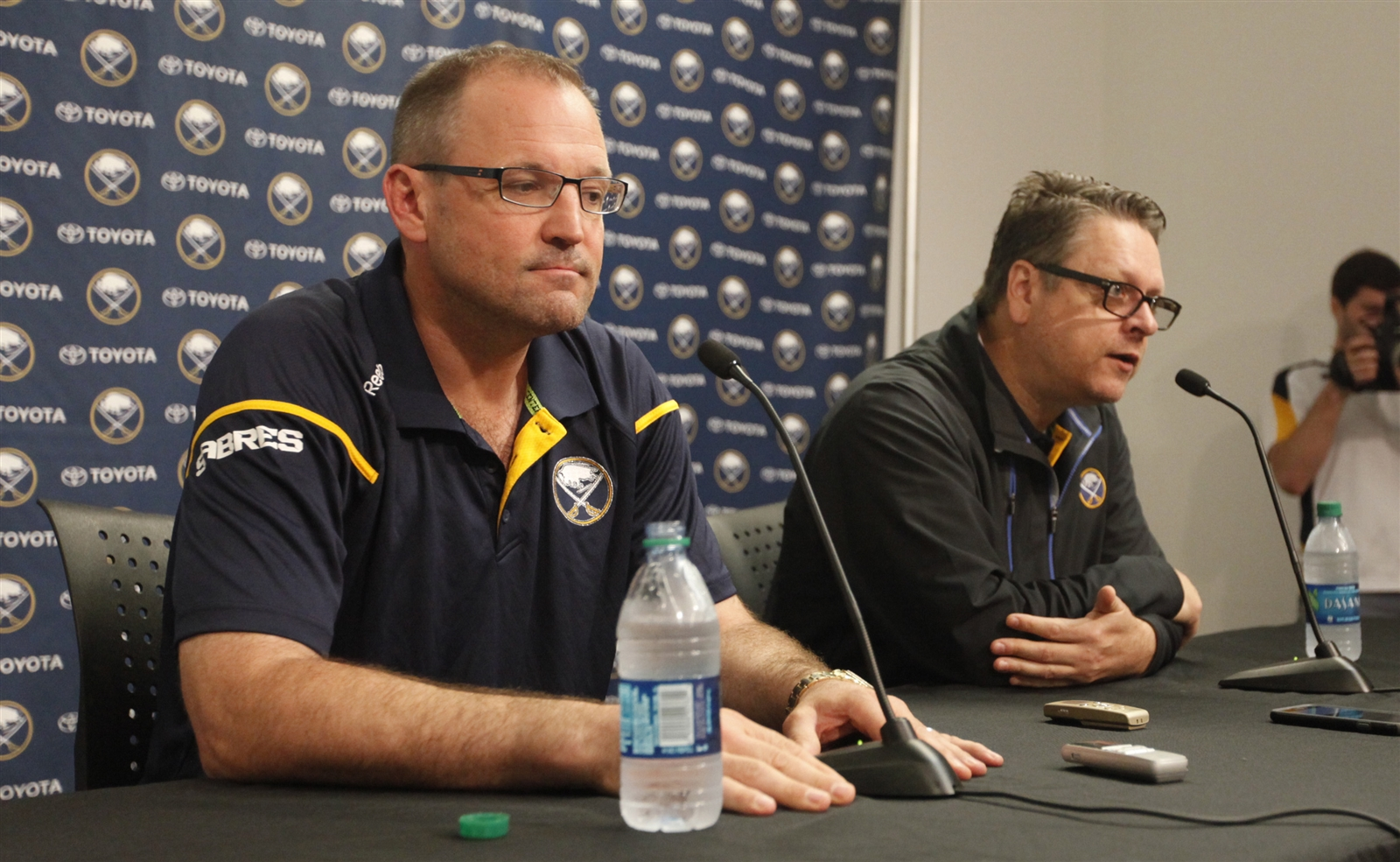 Dan Bylsma, left, and Tim Murray each had three years left on their contracts. (Harry Scull Jr./Buffalo News file photo)