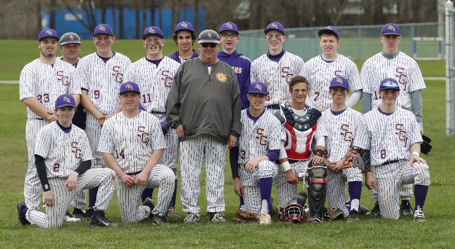 Rick DeKay, the coach of the Springville baseball team, takes a bow with his team after his 400th career win. (Photo by Harry Scull Jr. / Buffalo News)