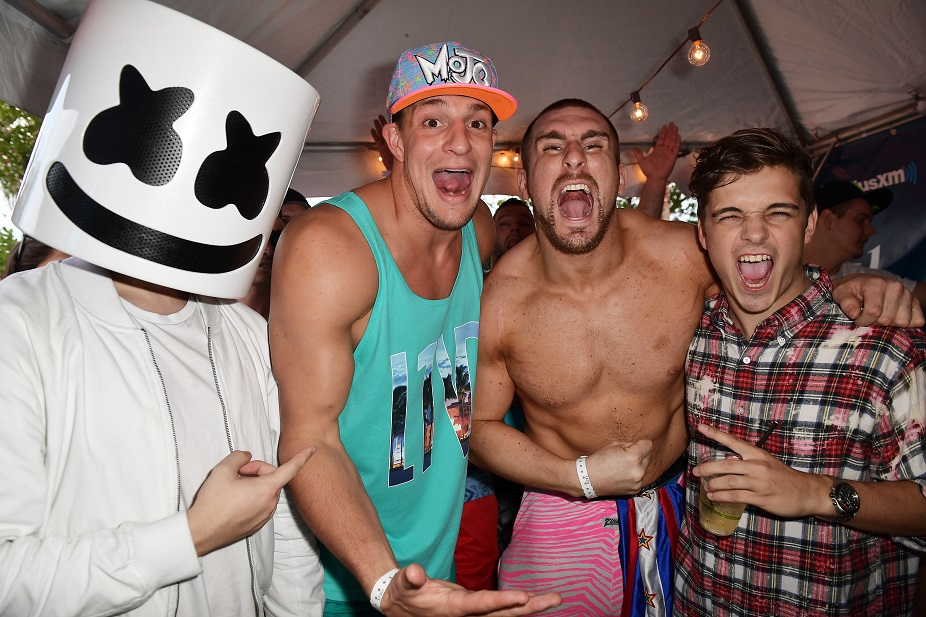 New England Patriots tight end Rob Gronkowski, second from left, is pictured next to wrestler Mojo Rawley during the SiriusXM Music Lounge at 1 Hotel South Beach on March 23 in Miami. Also pictured are DJs Marshmello and Martin Garrix. (Photo by Gustavo Caballero/Getty Images for SiriusXM)