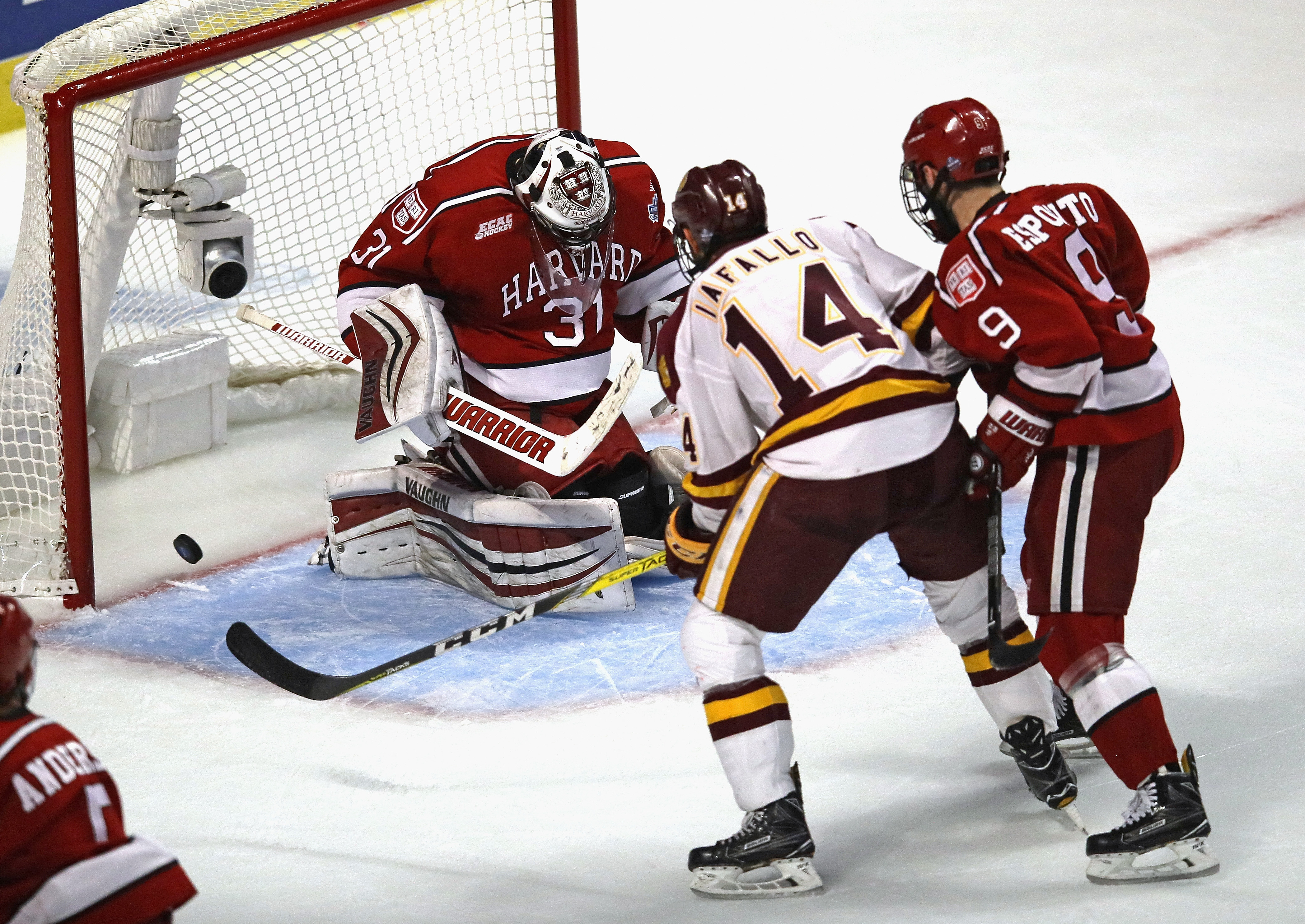 Eden native Alex Iafallo of Minnesota Duluth scores the game-winning goal with 26.6 seconds left against Harvard's Merrick Madsen at United Center in Chicago in a NCAA semifinal contest. (Getty Images)