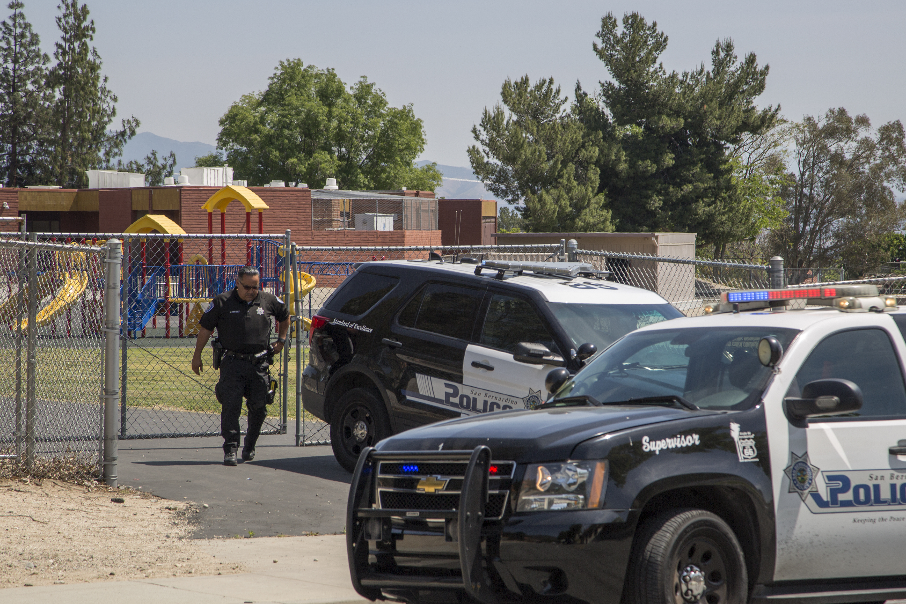 Police officers stand guard at North Park Elementary School following a shooting on campus on April 10, 2017 in San Bernardino, Calif. Two people died, including the suspected shooter, and two children were wounded in the apparent murder-suicide attack. (Getty Images)