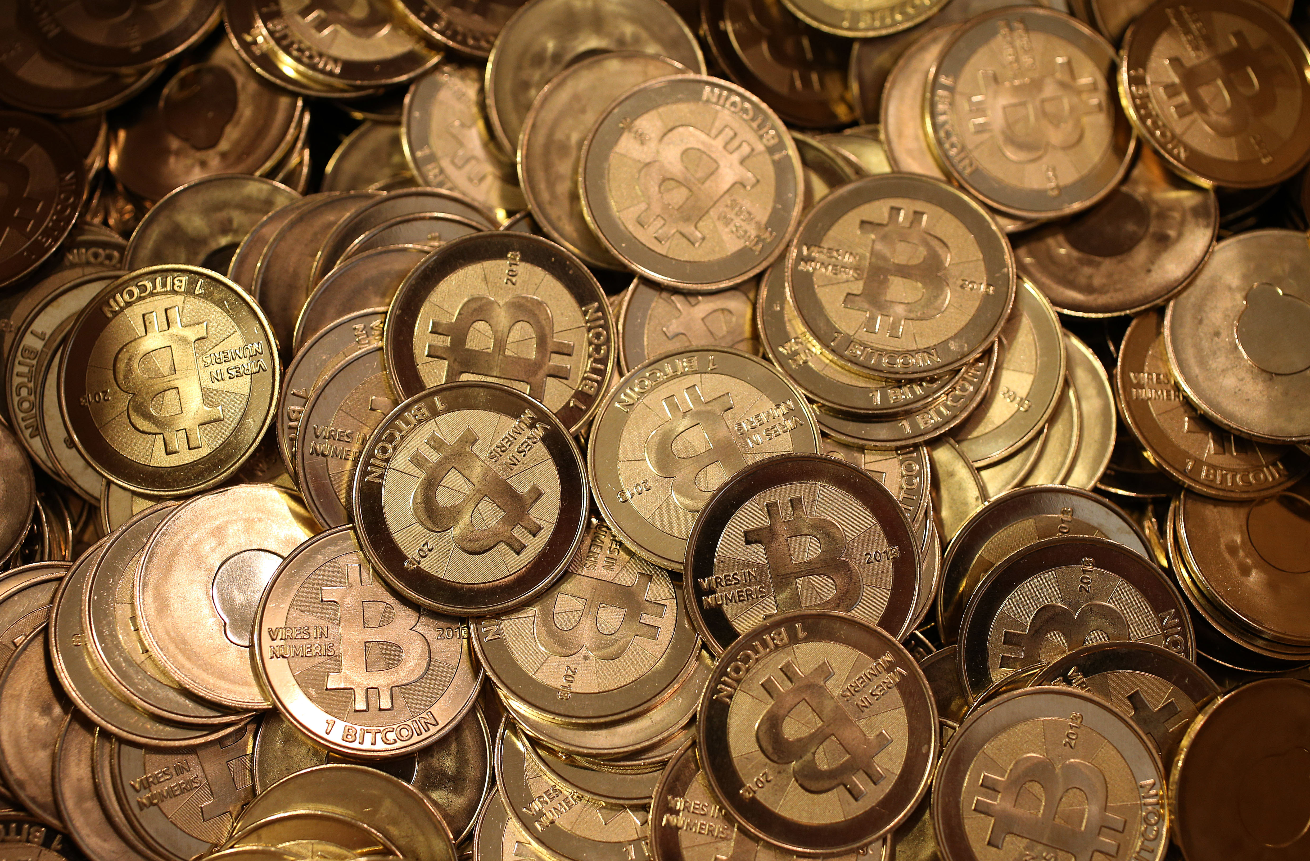 Described by advocates as a digital or virtual currency, bitcoin is a medium of exchange that, unlike the dollar, is completely decentralized. There is no central bank or middle man, so two parties can do business directly. (Getty Images)