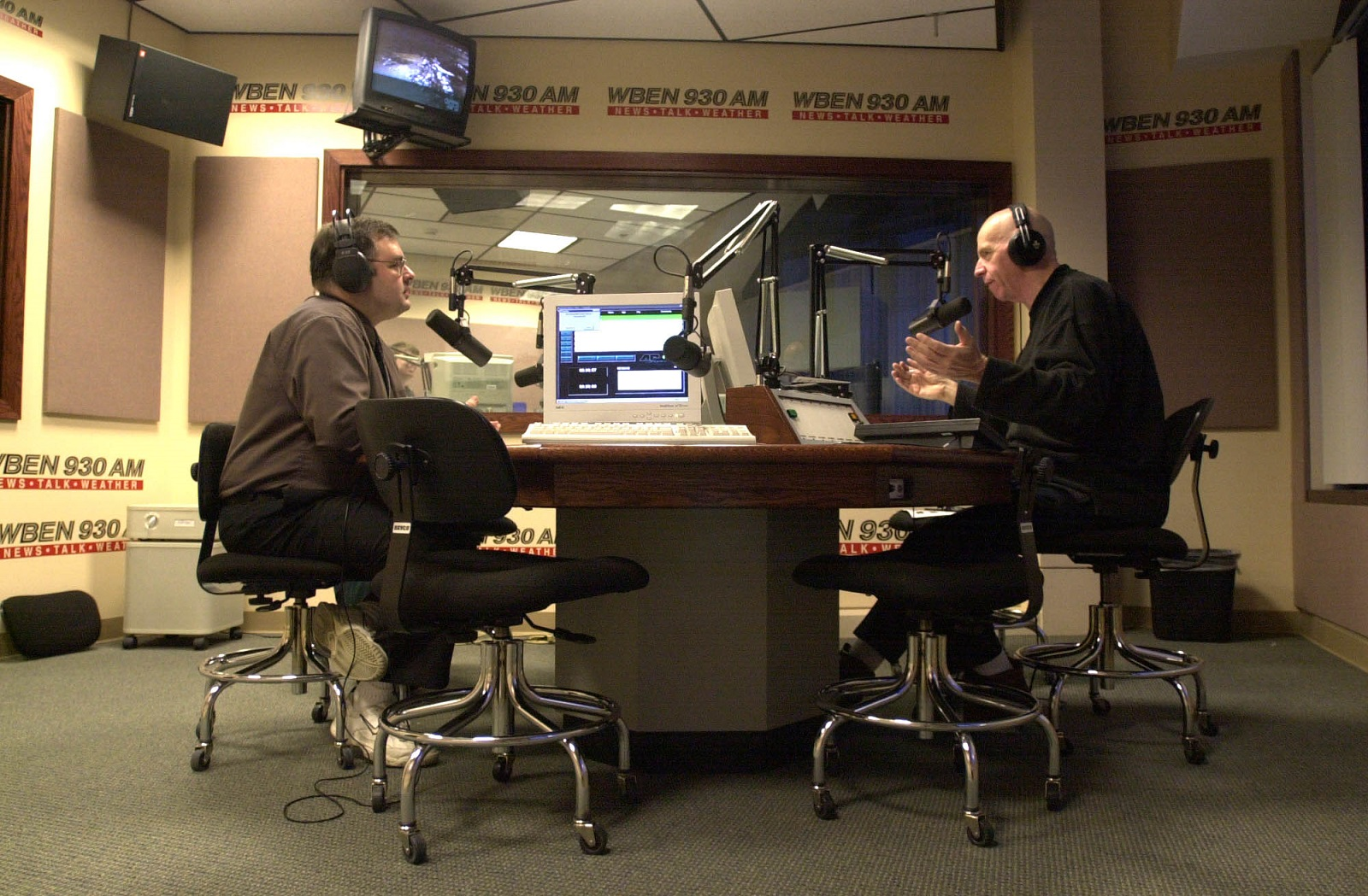 Bob Stilson (left) and Sandy Beach talk during a show in 2002 at the WBEN studios in Amherst. (Mark Mulville/Buffalo News)