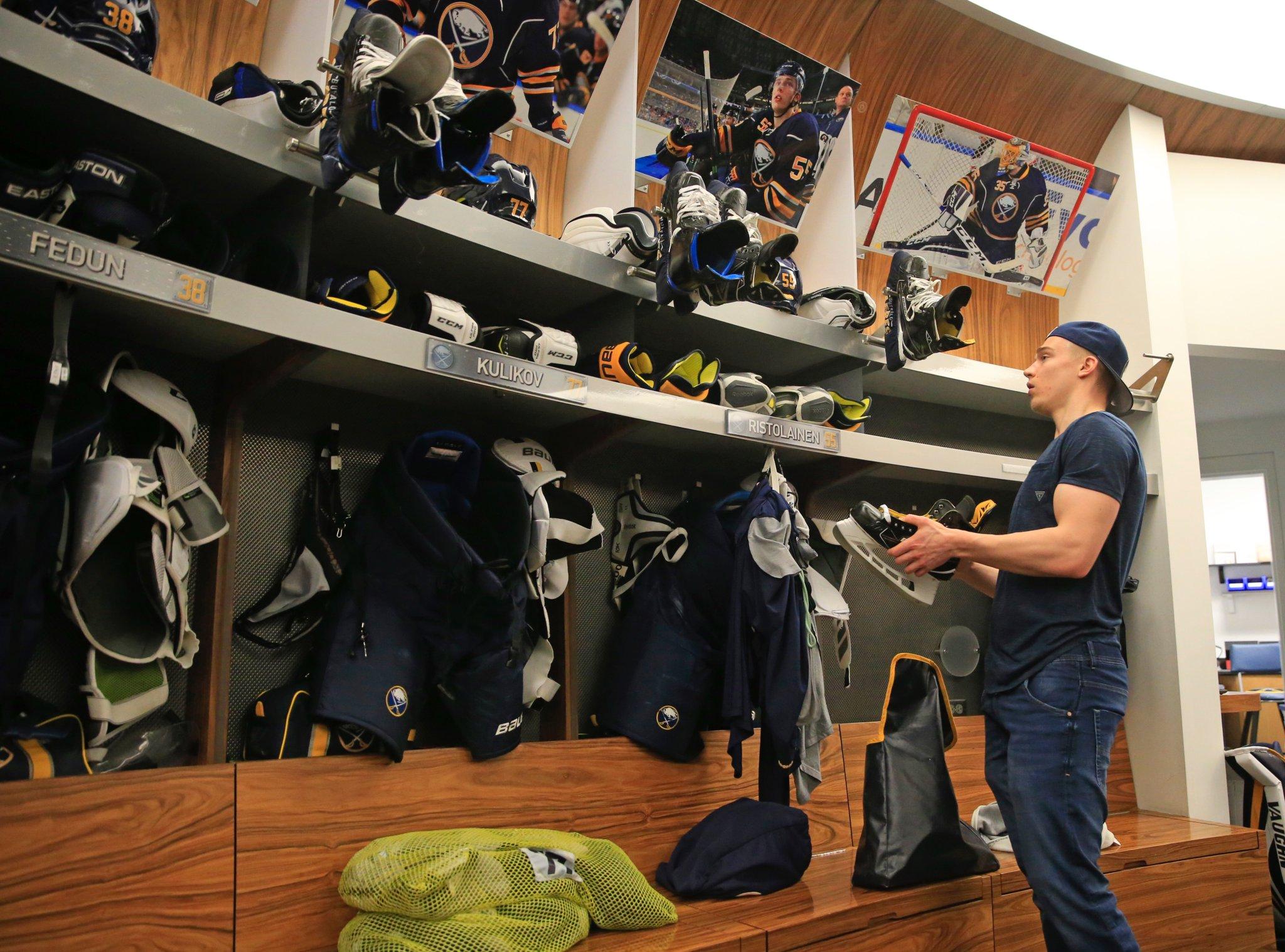 Sabres defenseman Rasmus Ristolainen goes through his locker during locker cleanout. (Harry Scull Jr./Buffalo News)