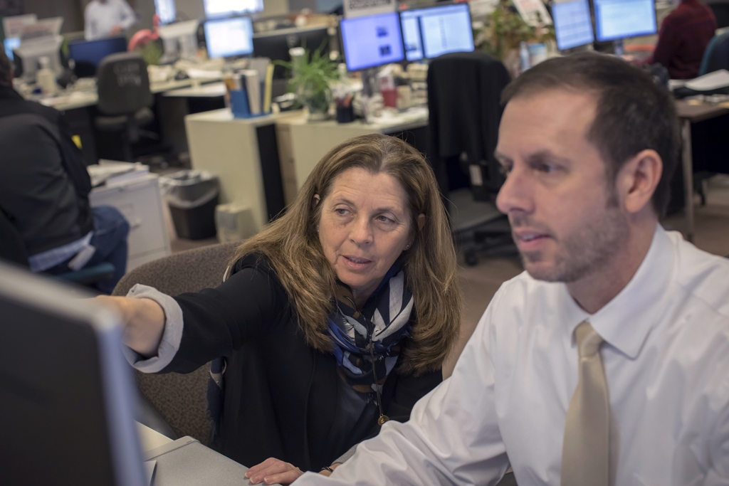 Cathaleen Curtiss, News director of photography and Vince Chiaramonte, design director go over photo selection and page design for the front page. (Derek Gee/Buffalo News)