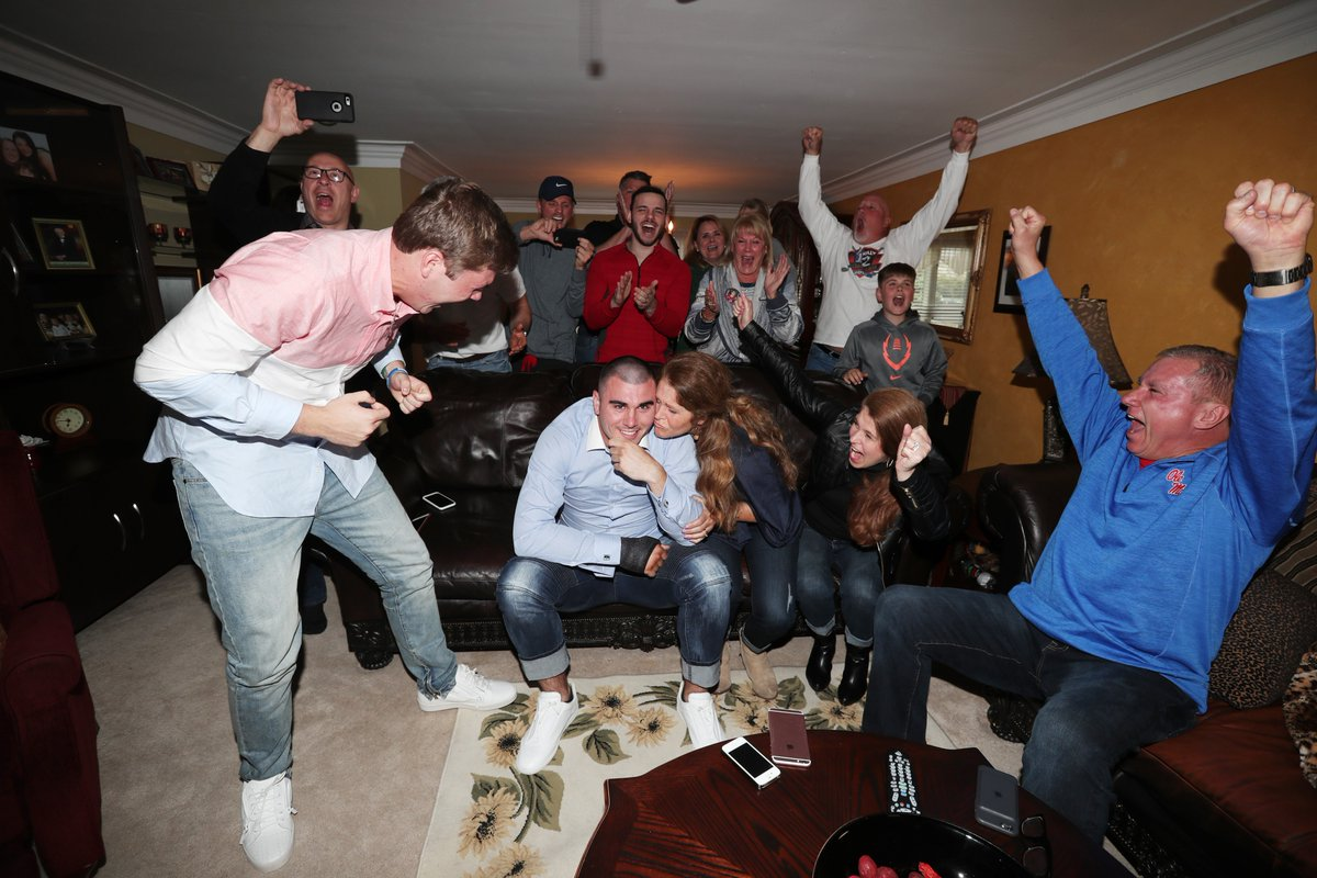 Chad Kelly's family and friends celebrate as he learns the Broncos drafted him. (James P. McCoy/Buffalo News)