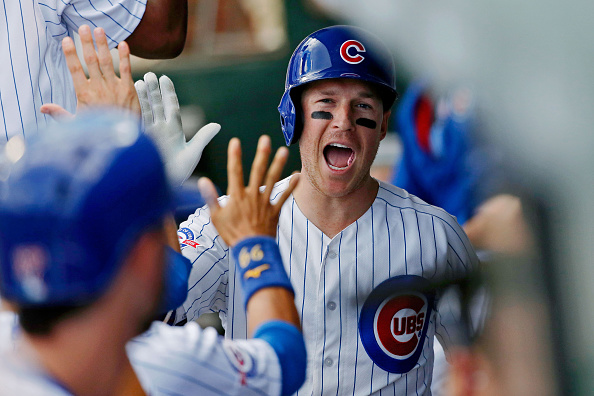 Chris Coghlan celebrates his home run for the Cubs during a game against Milwaukee last September in Wrigley Field (Getty Images).