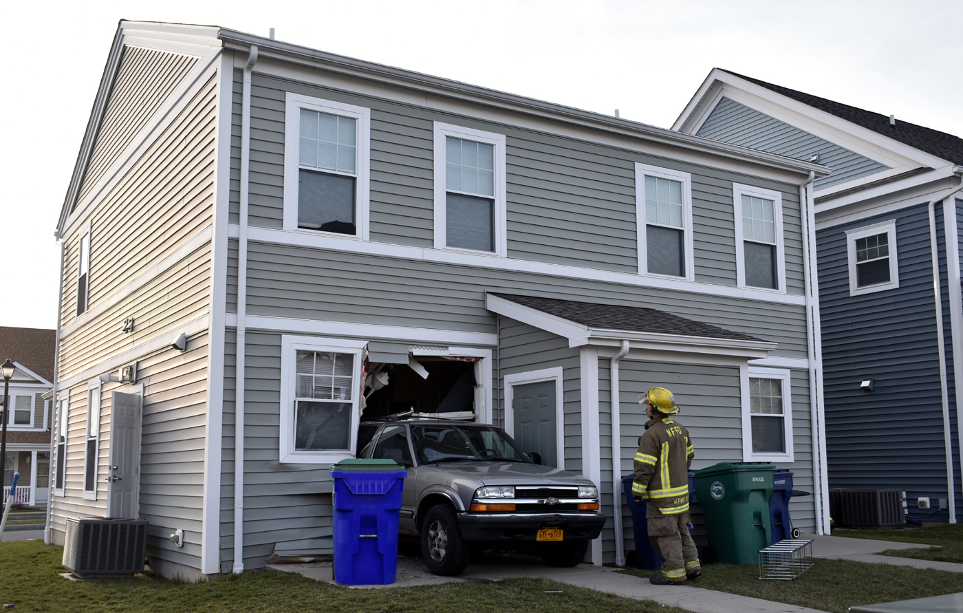 A car crashed into a home on Hope Boulevard in Niagara Falls. (Larry Kensinger/Special to The News)