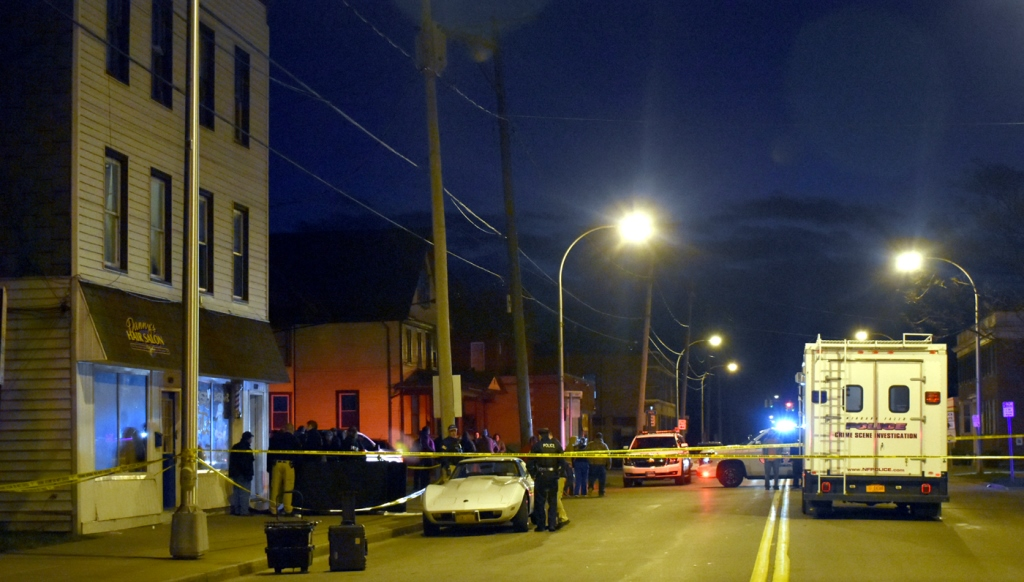 Niagara Falls police at the scene on Pine Avenue in Niagara Falls where Jose Hewitt was found dead Wednesday evening. (Larry Kensinger/Special to The News)