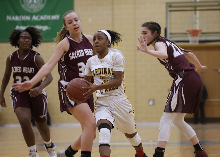 Cori Dickson heads to the basket for Cardinal O'Hara against two Sacred Heart defenders. The Hawks again are the top large school in girls basketball in Western New York. (Robert Kirkham / Buffalo News)