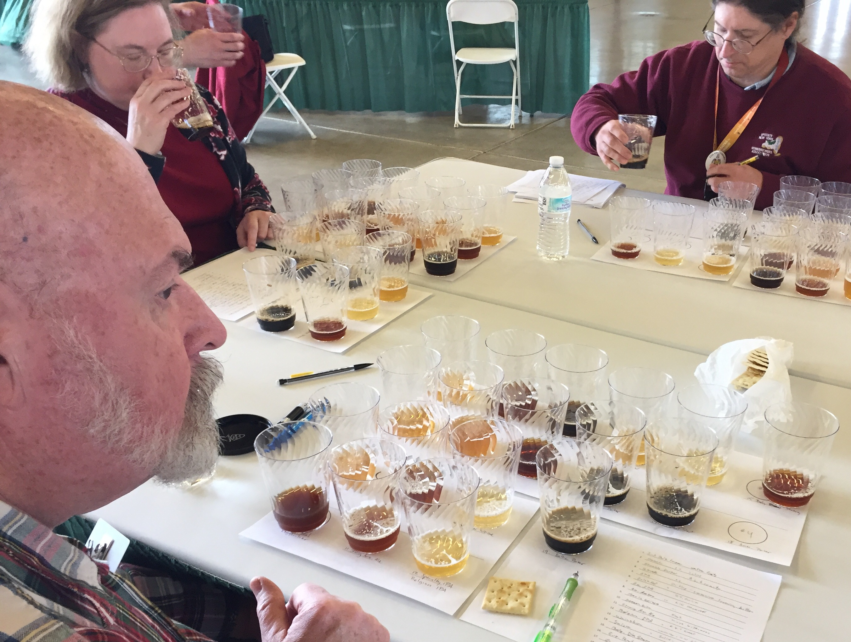 Beer judges Terry Felton, Kira Barnes and Thomas Barnes (from left to right) judge entries in the best of show round of the Erie County Fair homebrewing competition on Saturday, April 22, 2017.  (Photo provided by Erie County Fair)