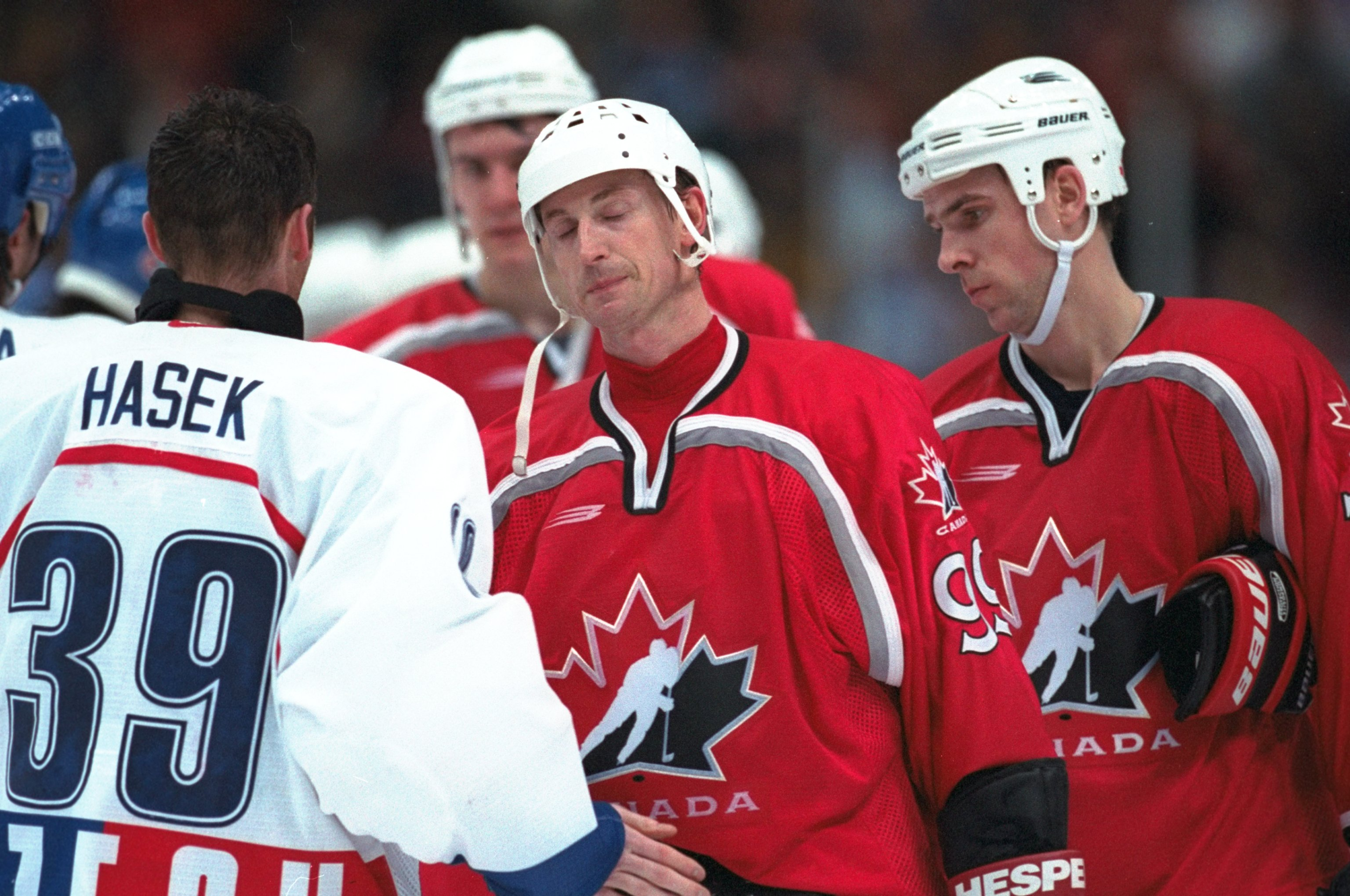 20 Feb 1998: Wayne Gretzky of Canada is consoled by Dominik Hasek of the Czech Republic at Big Hat Arena during the 1998 Olympic Winter Games in Nagano, Japan. Czech Republic beat Canada 2-1 in overtime to advance to the gold medal game.  Mandatory Credit: Brian Bahr /Allsport