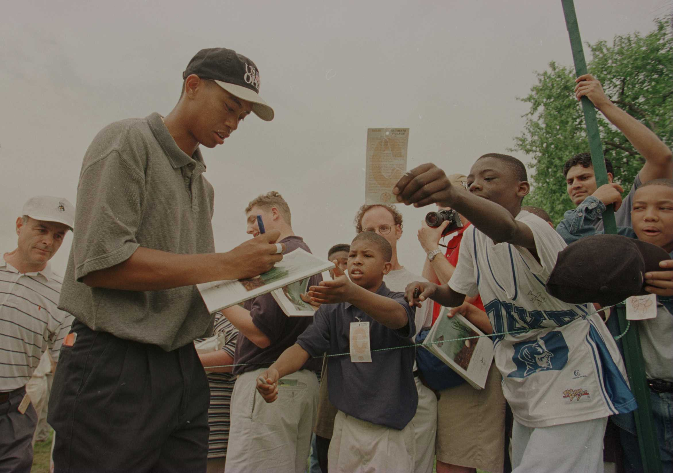 11 Jun 1996:  Tiger Woods signs autographs for his young fans during the practice round of the U.S. Open at Oakland Hills Country Club in Bloomfield Hills, Michigan. Mandatory Credit: J.D. Cuban/ALLSPORT