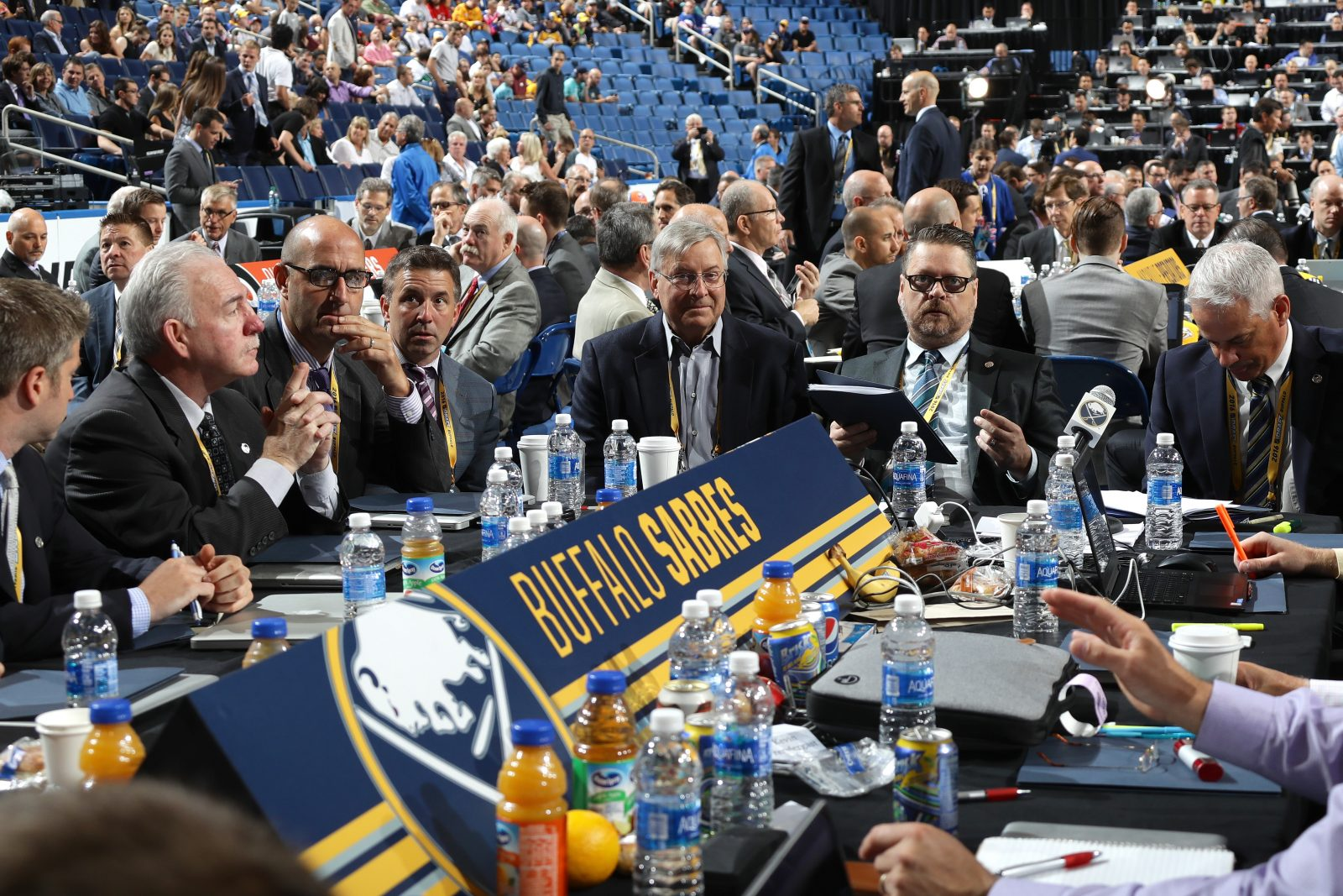 Kevin Devine and Jerry Forton, seated to the left of Pegula Sports and Entertainment President Russ Brandon and Sabres owner Terry Pegula, are among those who will help run things after the firings of GM Tim Murray and amateur scouting head Greg Royce, both seated to the right of Pegula.  (Getty Images)