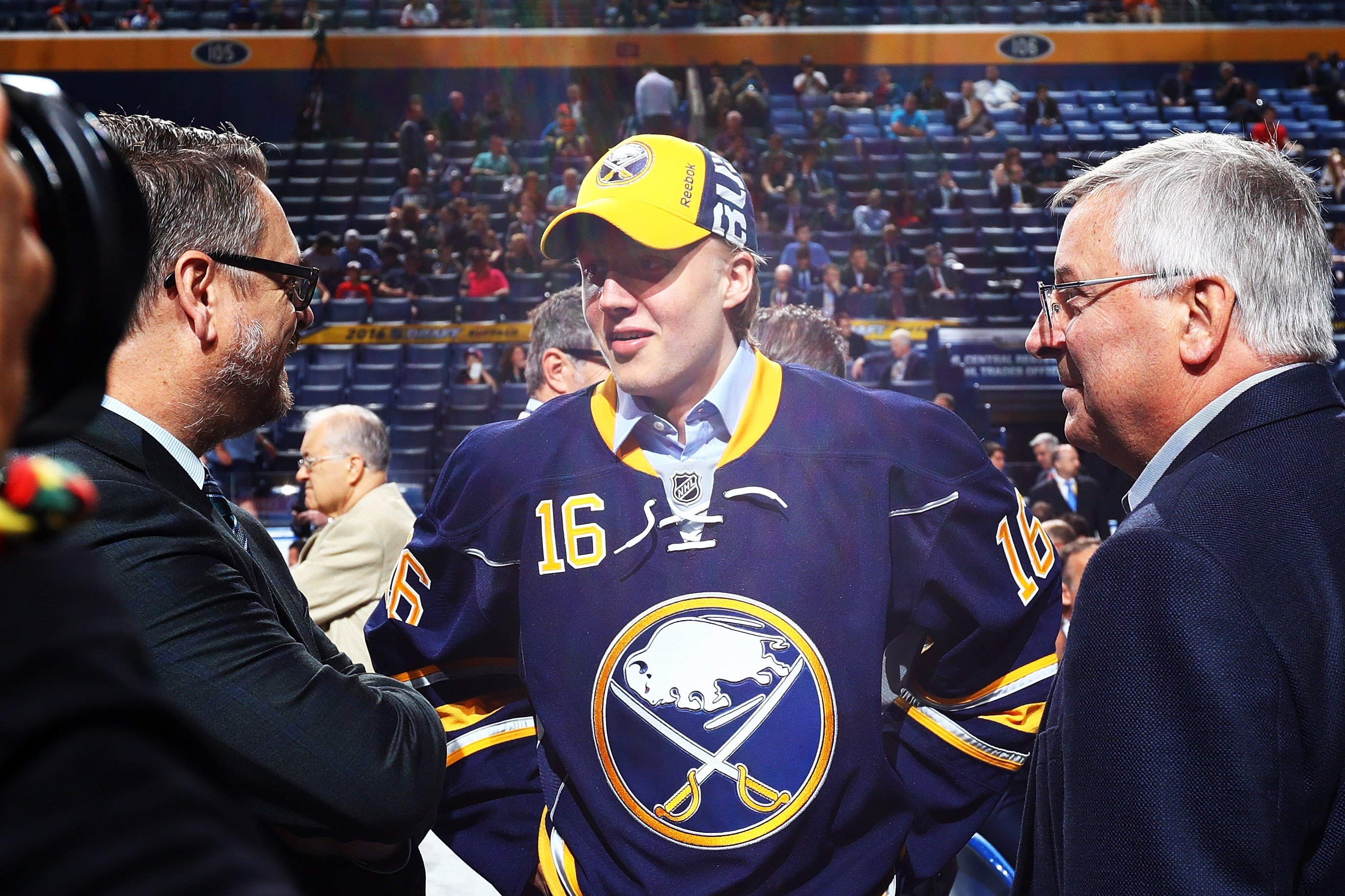 Sabres GM Tim Murray, left, and owner Terry Pegula, right, welcomed Alex Nylander to Buffalo last June and again Monday. (Getty Images)