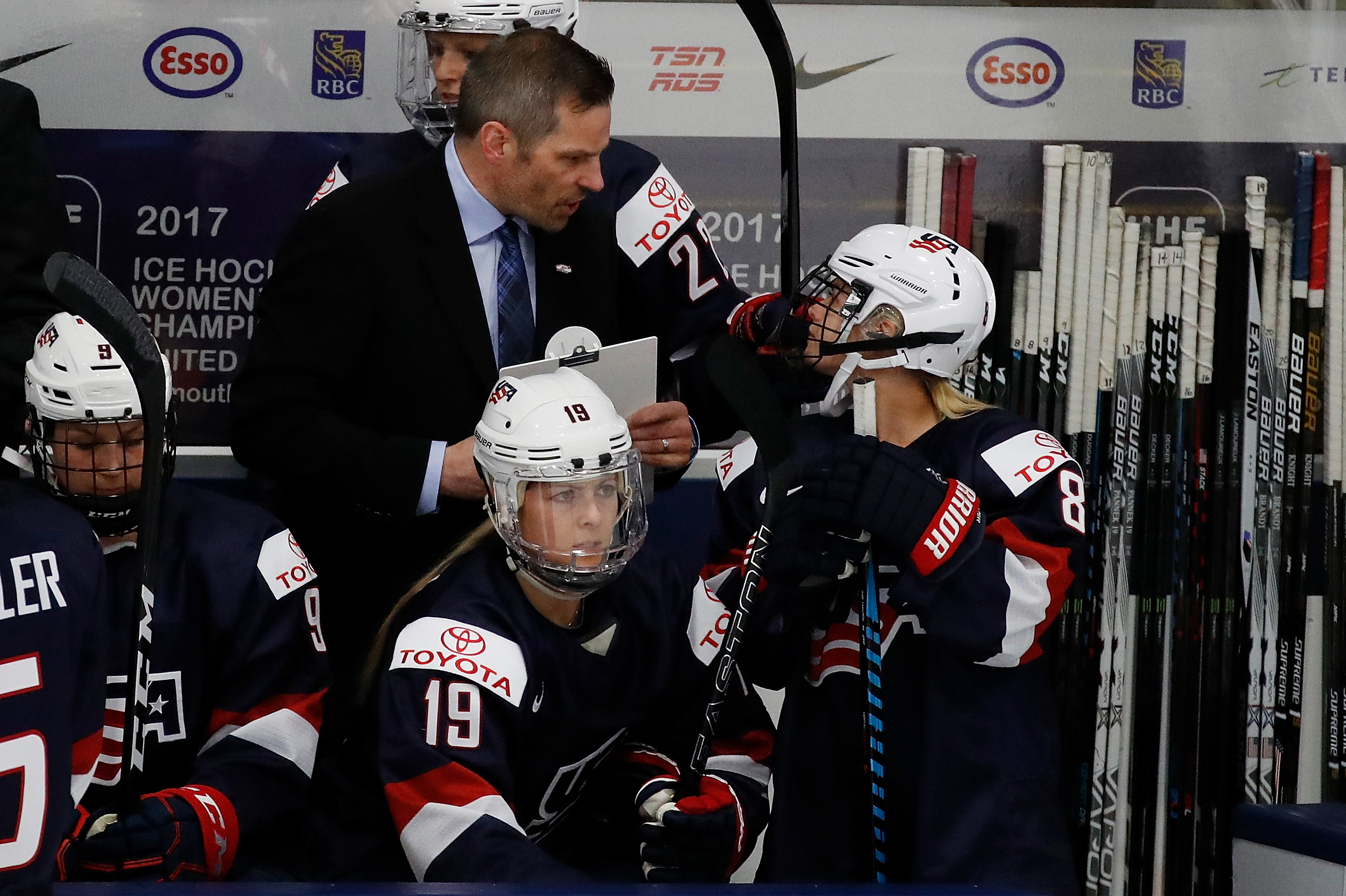 U.S. head coach Robb Stabber chatted with Emily Pfalzer during a preliminary round game at the IIHF Women's World Championship. (Getty Images)
