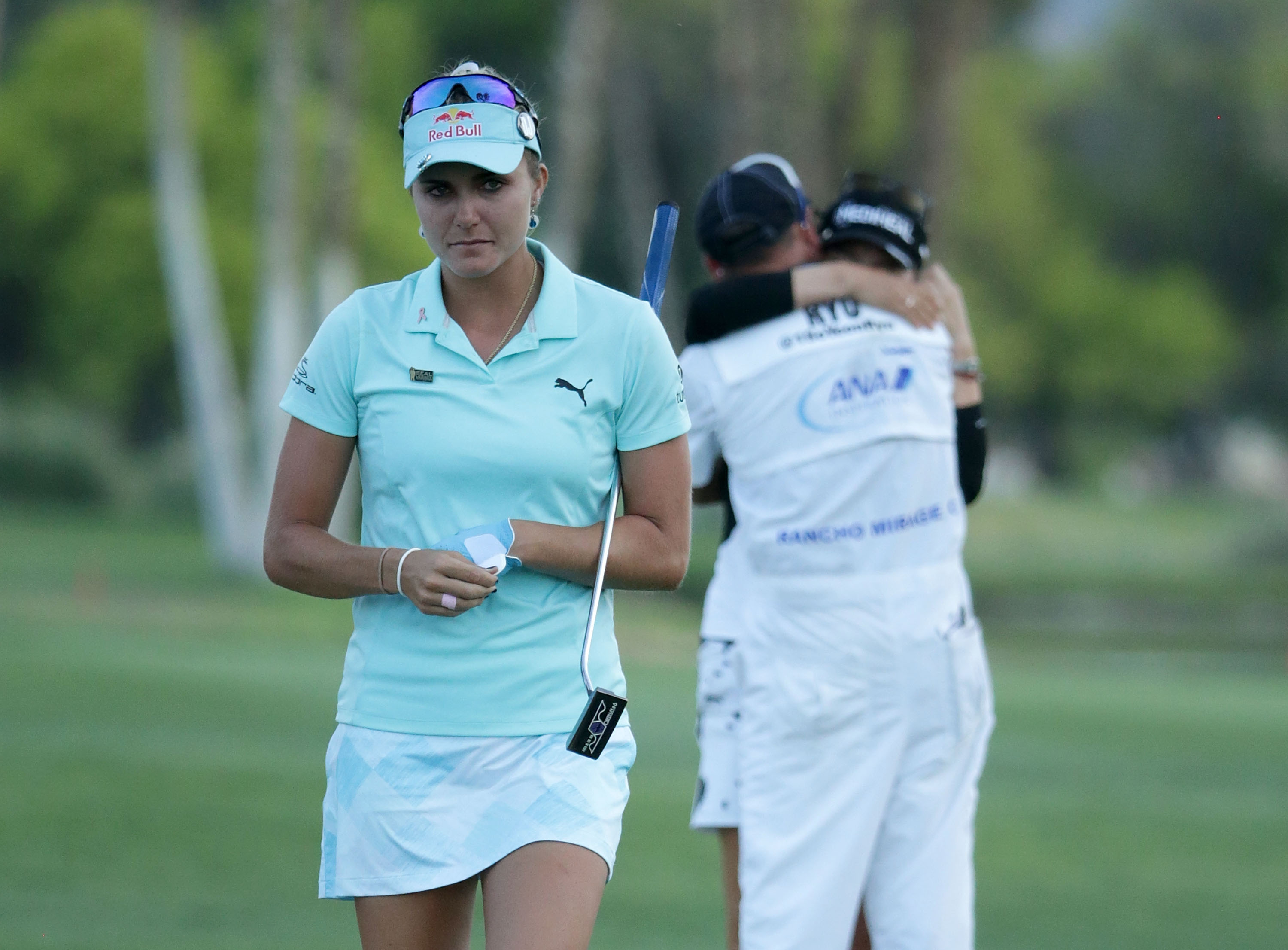 Lexi Thompson (L) walks off the 18th green as So Yeon Ryu of the Republic of Korea celebrates with her caddie after Ryu defeated Thompson in a playoff during the final round of the ANA Inspiration at the Dinah Shore Tournament Course at Mission Hills Country Club on April 2, 2017 in Rancho Mirage, California. (Getty Images)