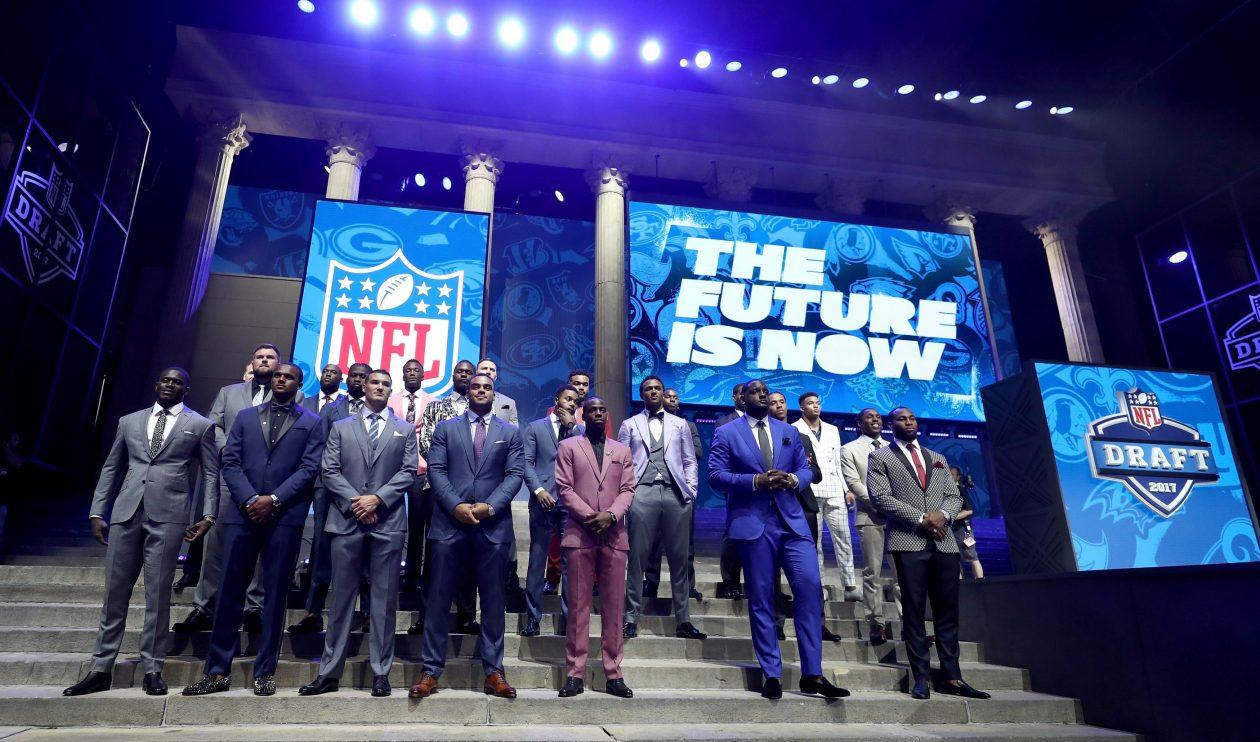 Draft prospects pose on stage before the beginning of the 2017 NFL Draft. (Getty Images)