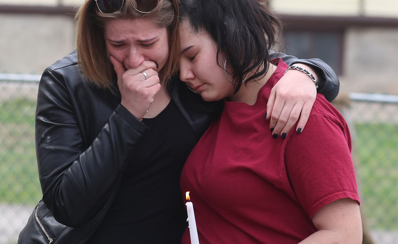 A vigil was held outside of 617 Pine Ave. in Niagara Falls for Jose Hewitt, who was killed on Wednesday, April 13, 2017. Nieces Vallissa Lawson, left, and Azrieana Hewitt console each other. (John Hickey/Buffalo News)