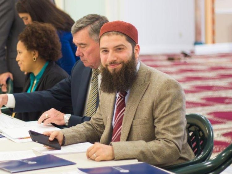Hassan Shibly and then-CBP Commissioner R. Gil Kerlikowske, who is sitting next to him, took part in a Florida forum on relations between the CBP and Muslim community. (Photo courtesy of Hassan Shibly)