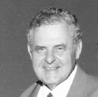 SCHMIT, Arnold B.