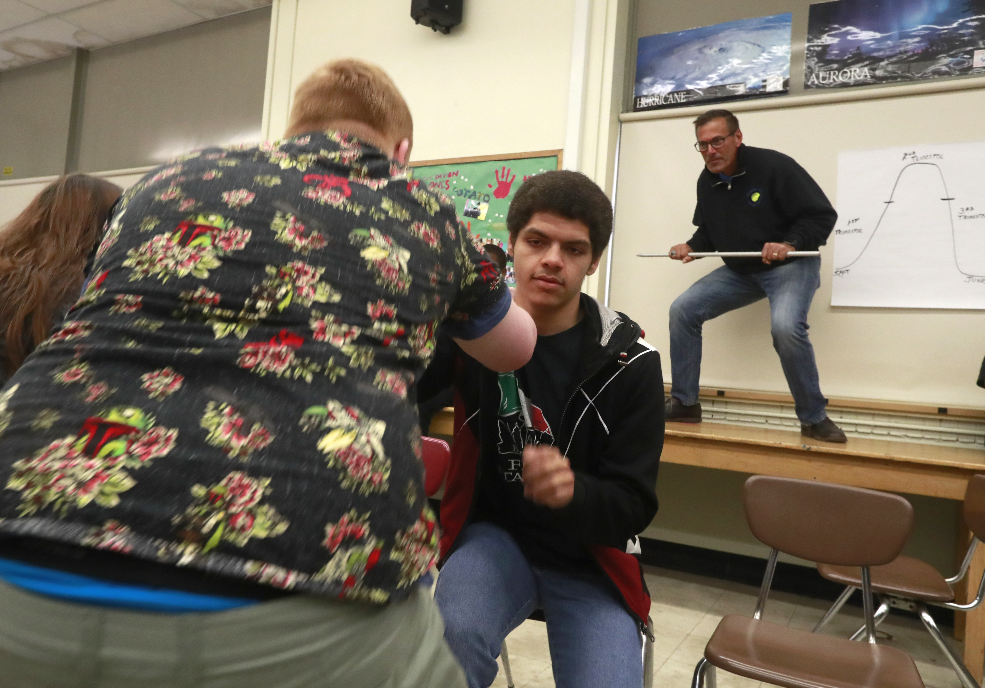 Teacher Matt Chimera, on right, runs the 'Pick Me Up' session as Sean Menk, left, and Richard Pates participate in this free-form high school for at-risk youth in the Kenmore-Town of Tonawanda School District at the Middle School in Kenmore, N.Y. on  Friday April 28, 2017. (John Hickey/Buffalo News)