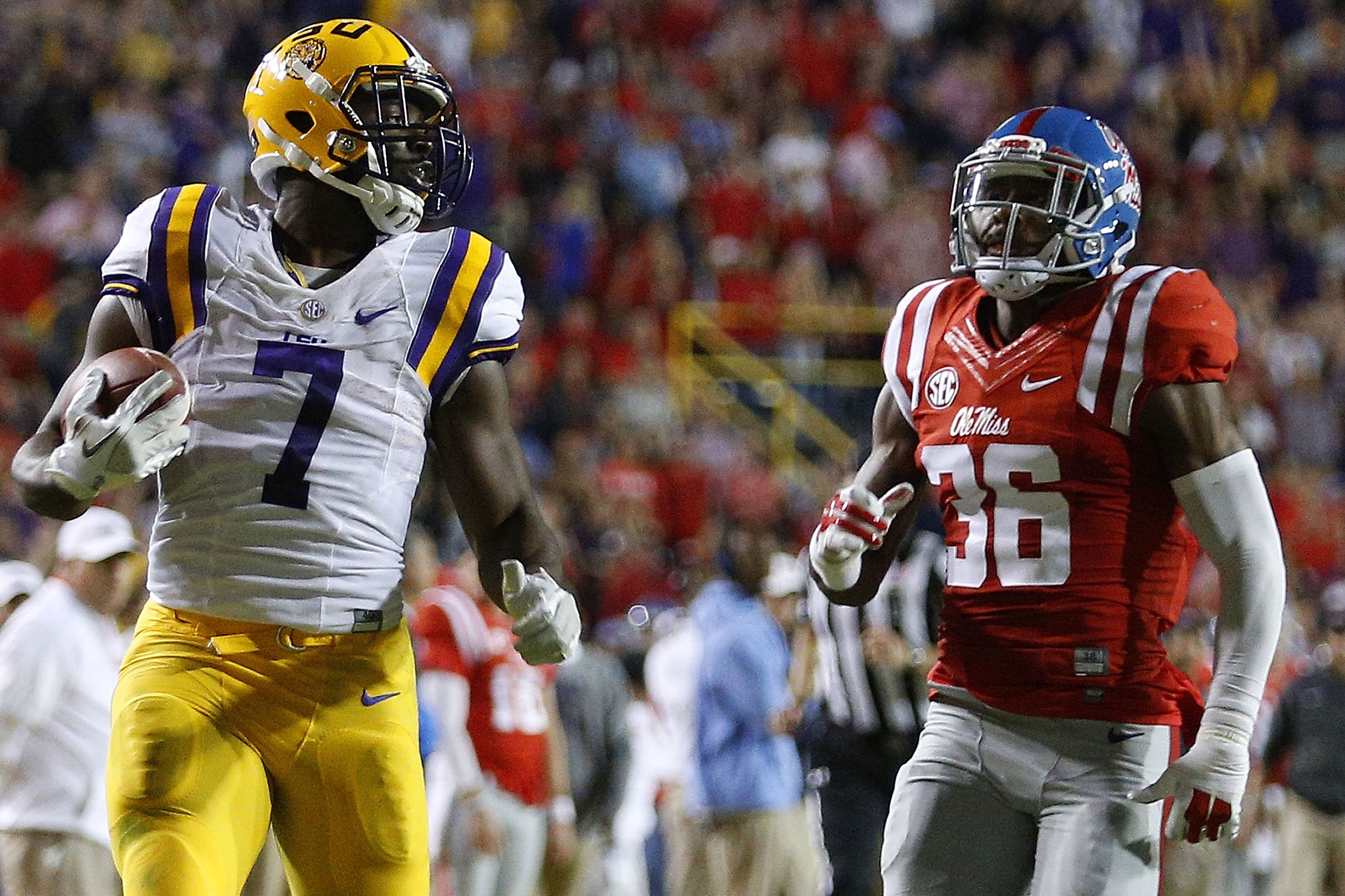 Leonard Fournette, left, of the LSU Tigers heads a strong class of running backs. (Photo by Jonathan Bachman/Getty Images)