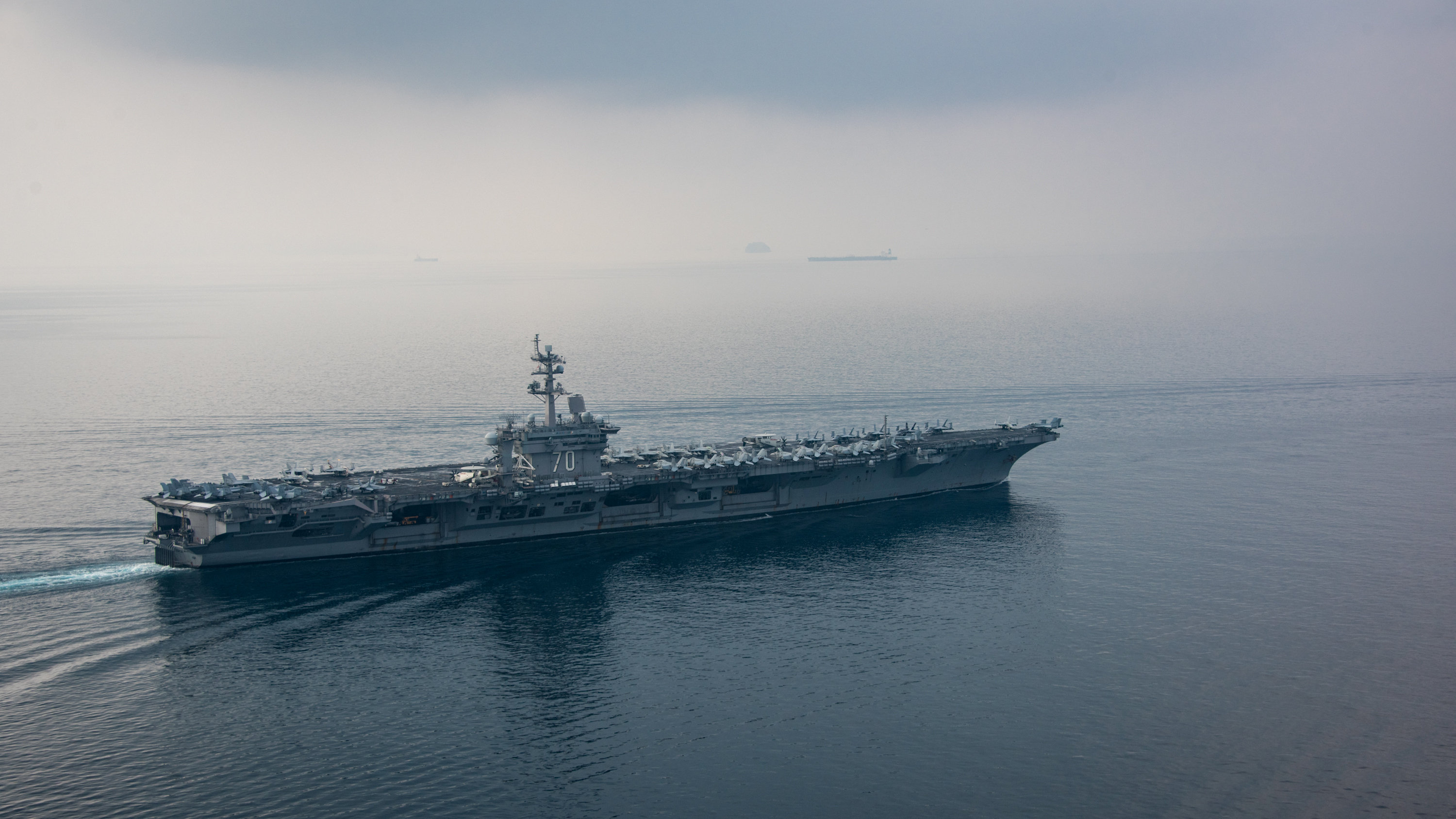 The USS Carl Vinson aircraft carrier, together with two guided-missile destroyers and a cruiser, are expected to arrive in the waters off the Korean Peninsula in the next few days and stage a combined tactical operation with the South Korean navy. (U.S. Navy via The New York Times)
