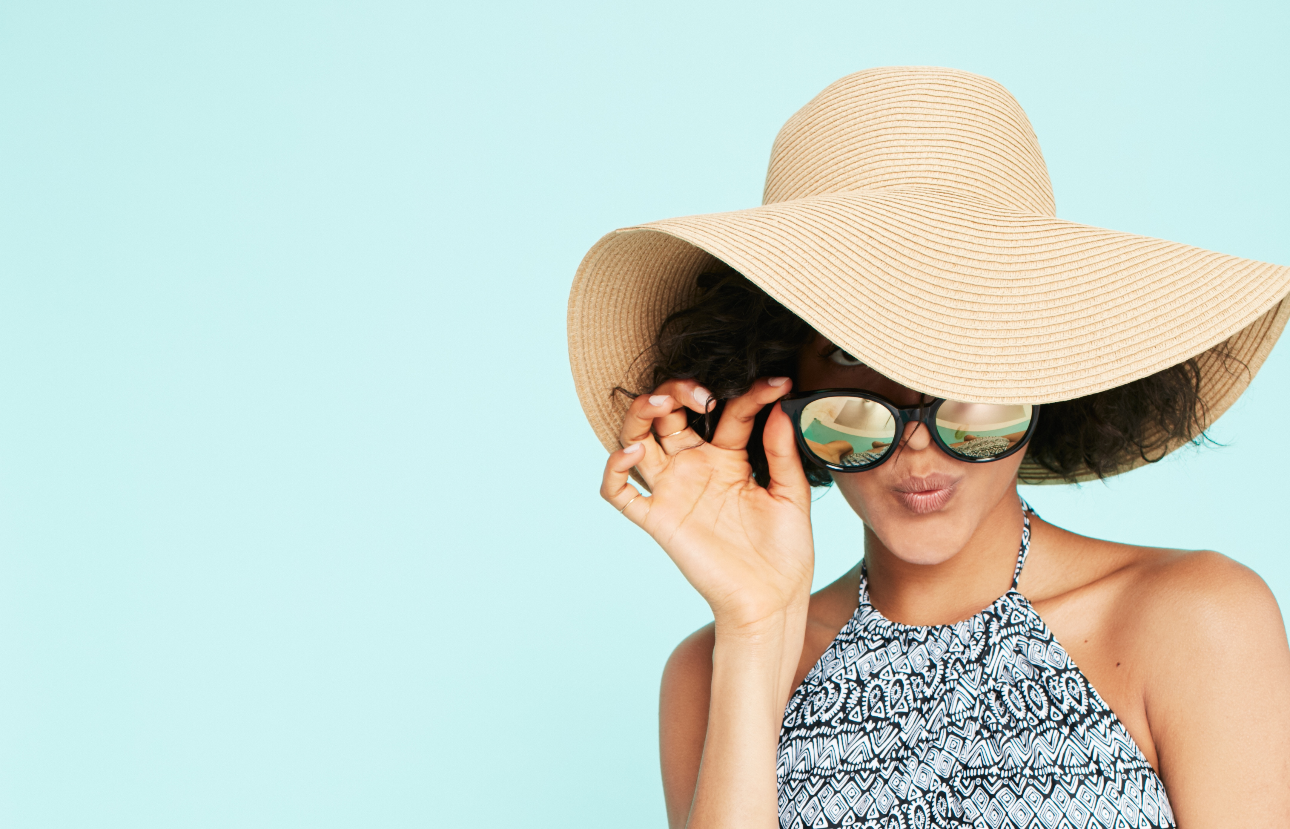 Our checklist includes a sun hat and sunglasses. (Photo courtesy Old Navy)