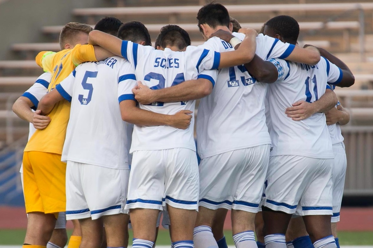 UB men's soccer huddles before a match in 2015. The program was cut on Monday. (Don Nieman/Special to The News)