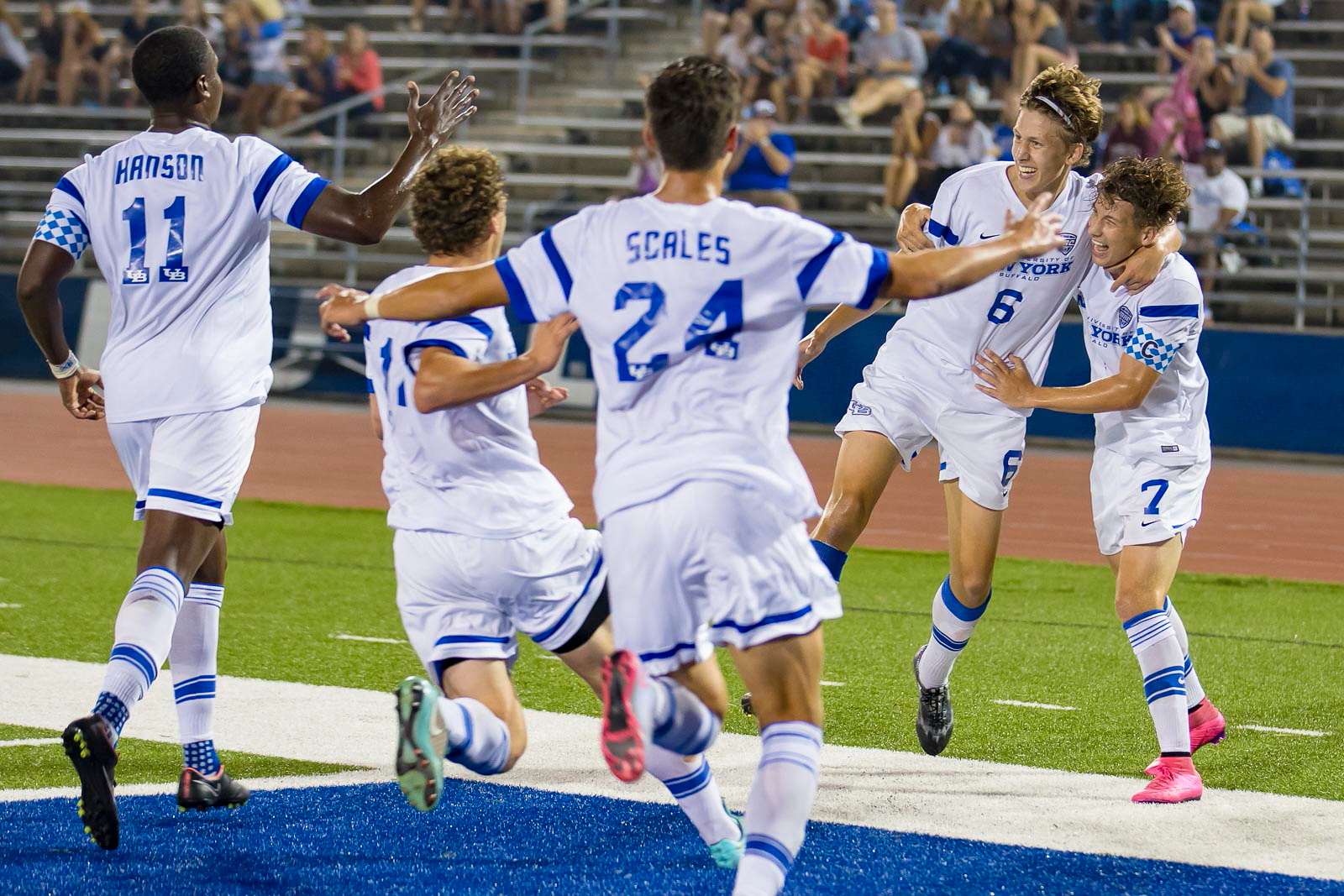 UB men's soccer celebrates a goal in 2015. The program will no longer exist after spring 2017 due to budget cuts. (Don Nieman/Special to The News)