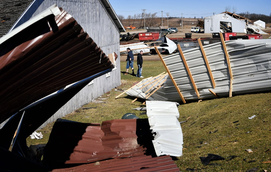 This torn siding found on Tuesday, March 7, 2017 in Clarks Grove, Minn. is likely from the town hall and fire department a block away. Residents of Clarks Grove cleaned up after a likely tornado tore through town Monday night. Clarks Grove is about 90 miles south of the Twin Cities. (Minneapolis Star Tribune/TNS)