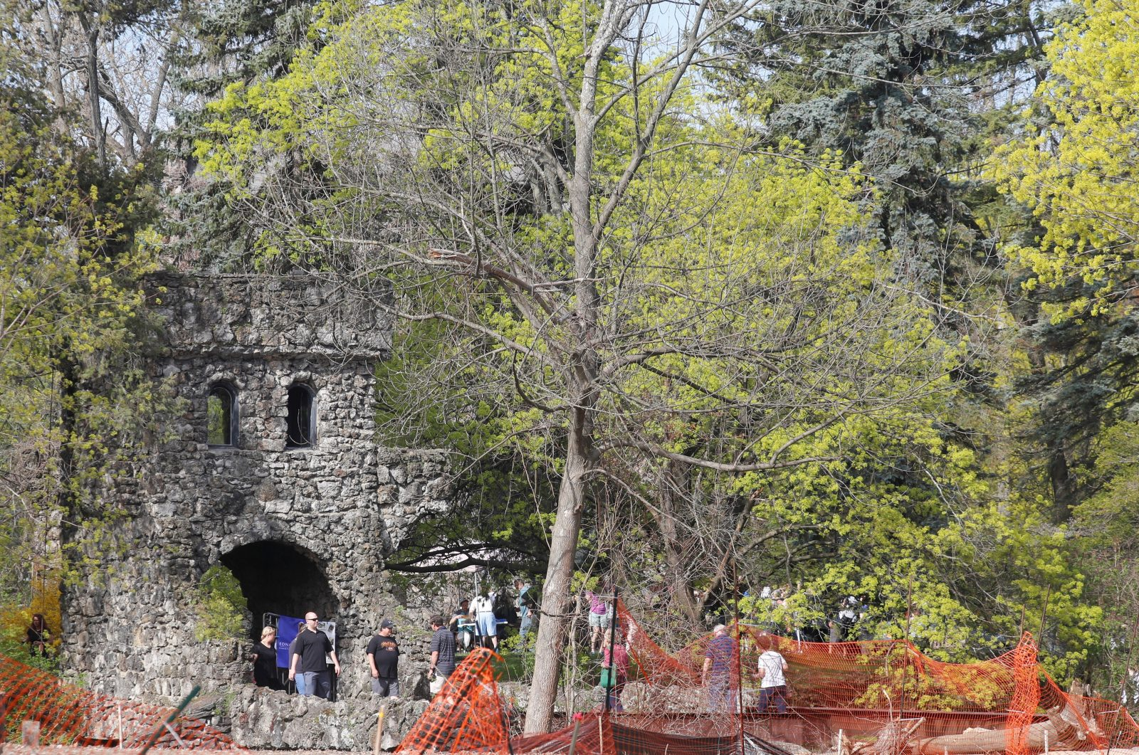 People attending the first day of an estate sale travel in and out of the walkway and gate to the castle on Oakgrove Drive in Williamsville. (John Hickey/News file photo)