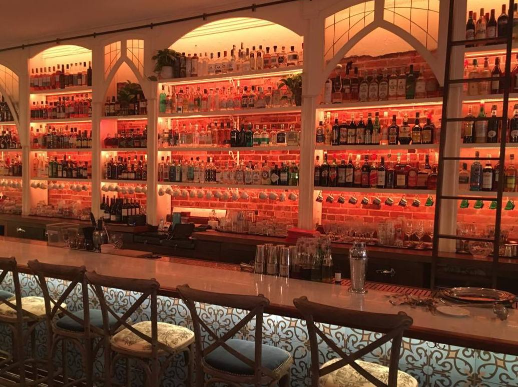 The illuminated back bar is a focal point of the room. (Angelica Tea Room)