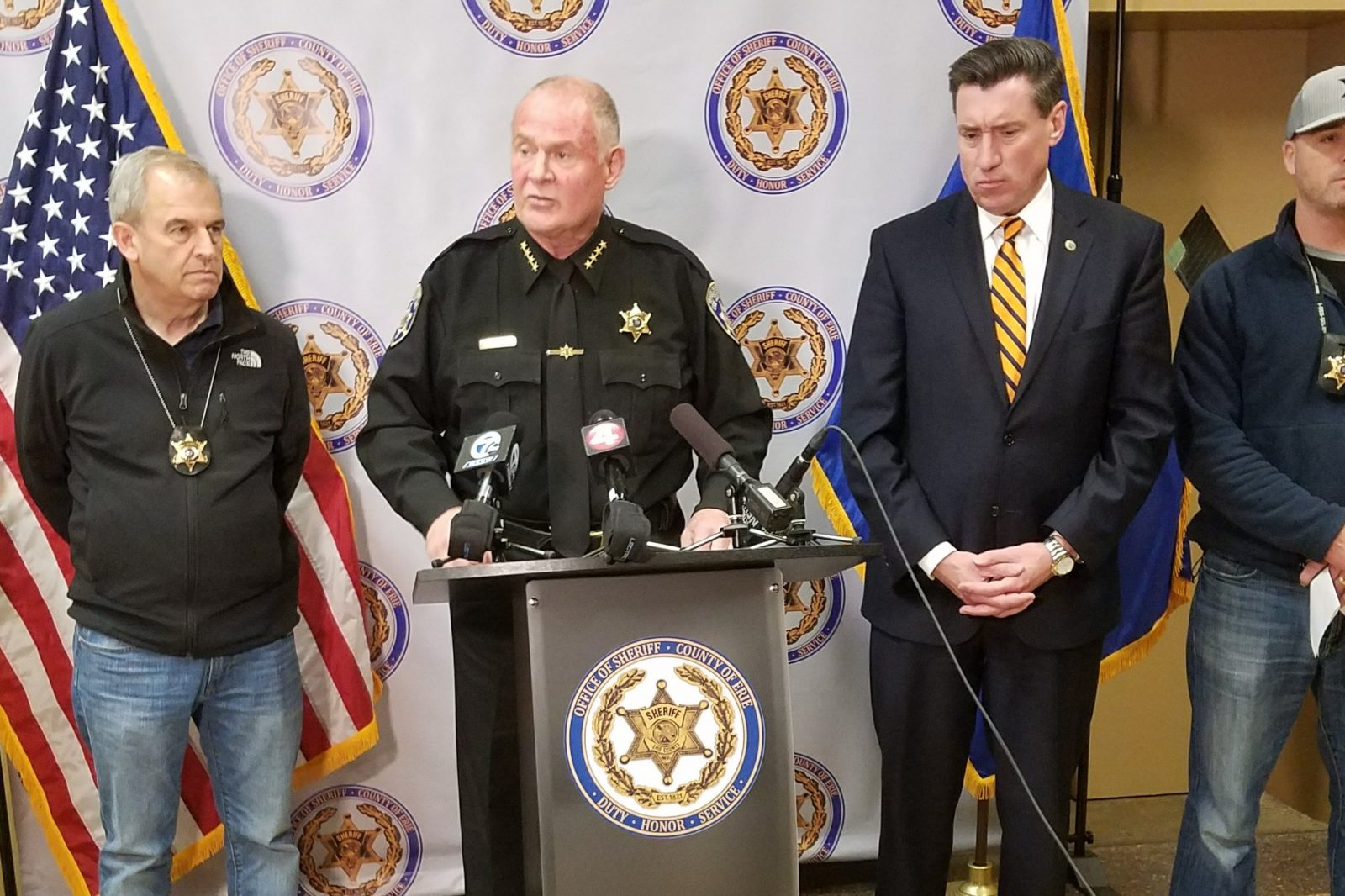 Sheriff Timothy Howard, at podium, along with District Attorney John Flynn, right, and other law enforcement officials, announces arrest of Eddie Fields. (Harold McNeil/Buffalo News)