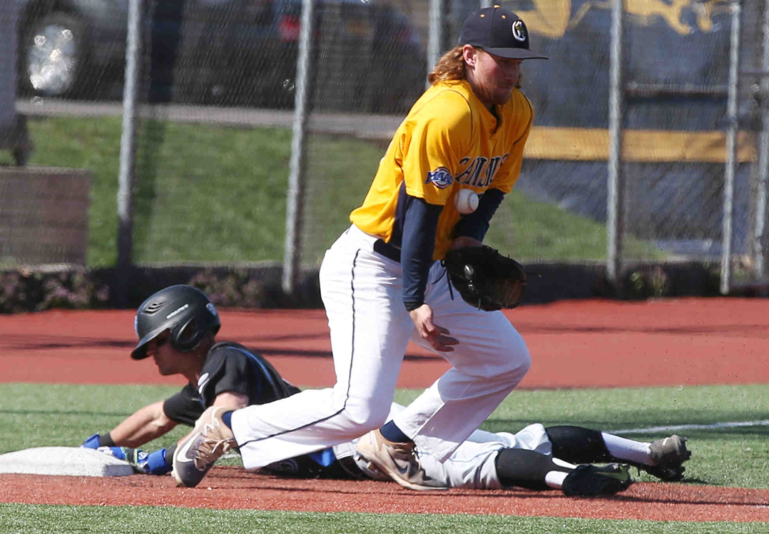 Buffalo infielder Brian Dudek (5) slides safely into third as Canisius' Liam Wilson (33) tries to stop the ball in the third inning. (James P. McCoy/Buffalo News)